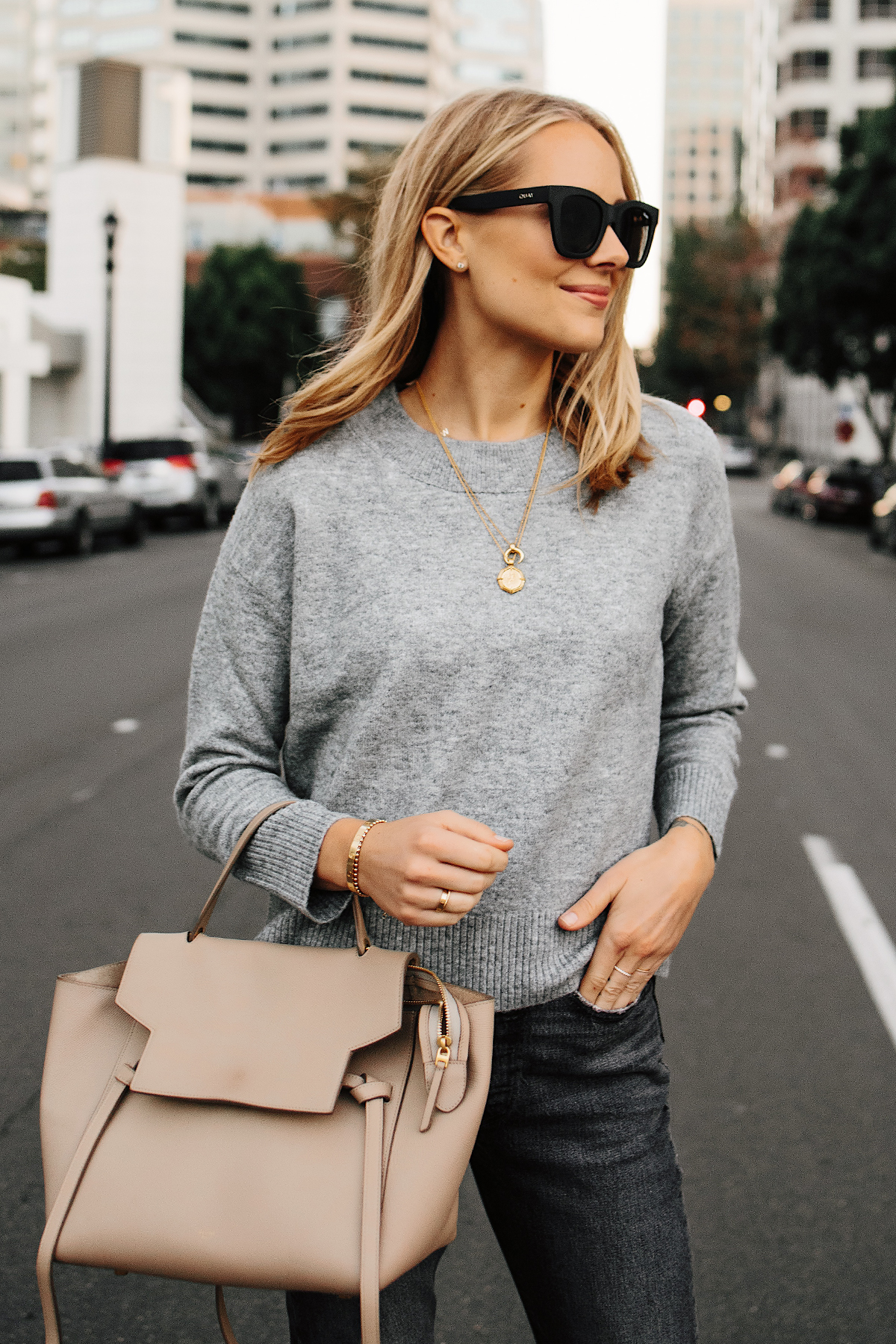 Blonde Woman Wearing Levis Oversized Grey Sweater Celine Mini Belt Bag Fashion Jackson San Diego Fashion Blogger Street Style