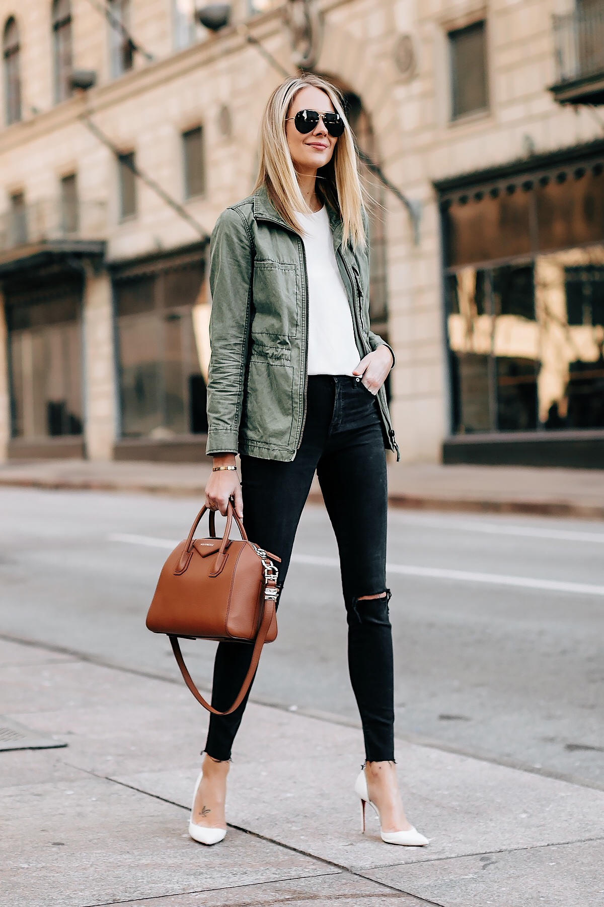 0dc67546769 Blonde Woman Wearing Madewell Utility Green Jacket White Top Black Ripped  Jeans White Pumps Givenchy Antigona