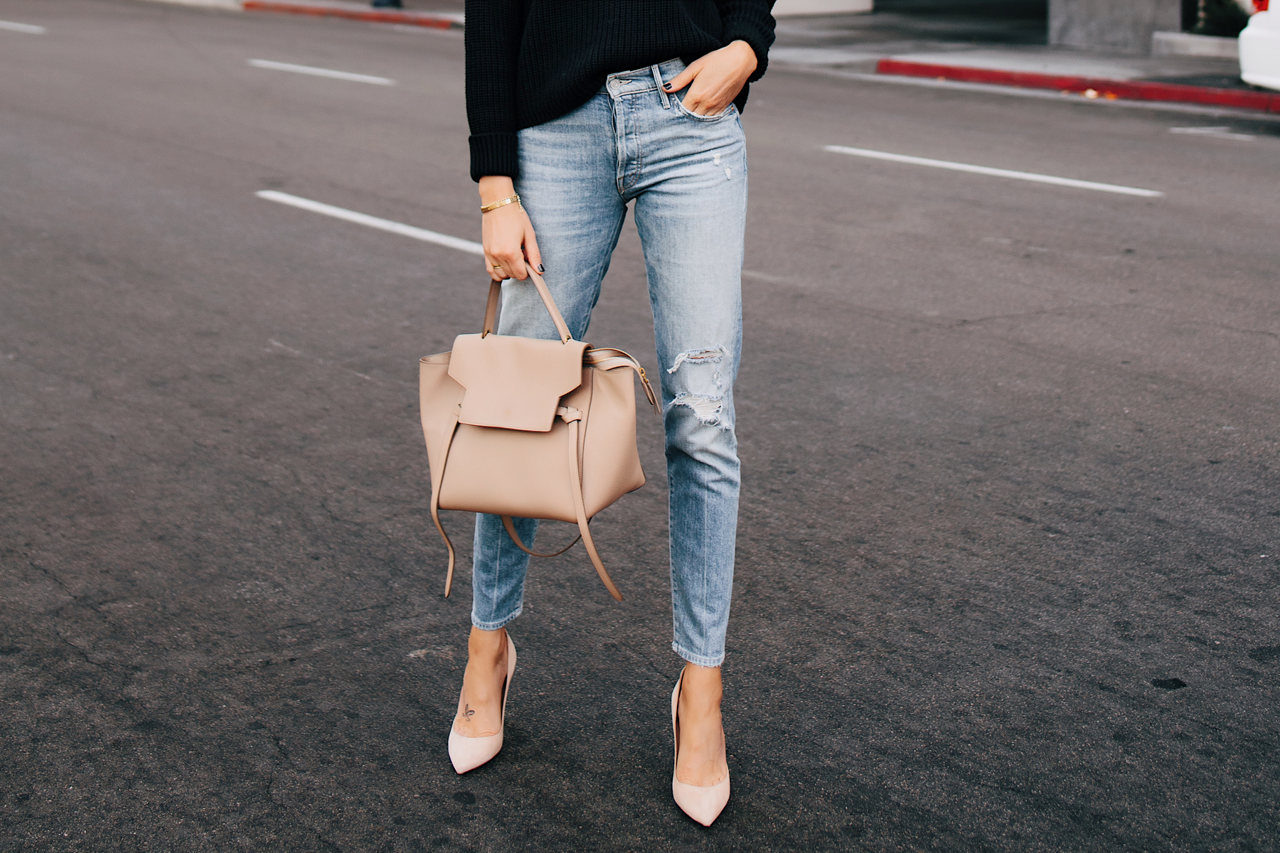 Woman Wearing Mother Denim Ripped Jeans Black Sweater Nude Pumps Celine Mini Belt Bag Taupe Fashion Jackson San Diego Fashion Blogger Street Style