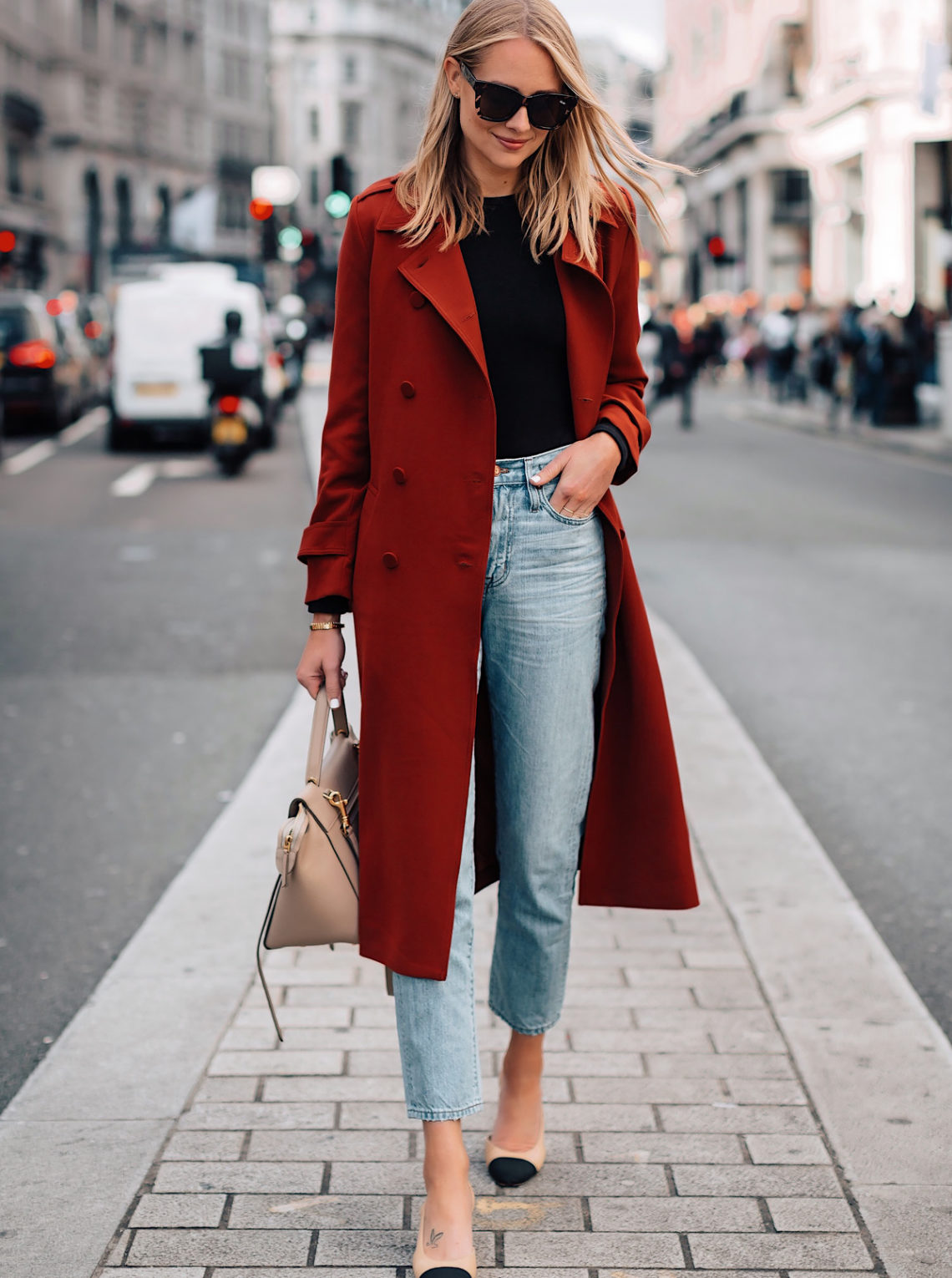 e2a5df1afc Blonde Woman Wearing Red Trench Coat Black Top Relaxed Jeans Outfit Chanel  Slingbacks Fashion Jackson San