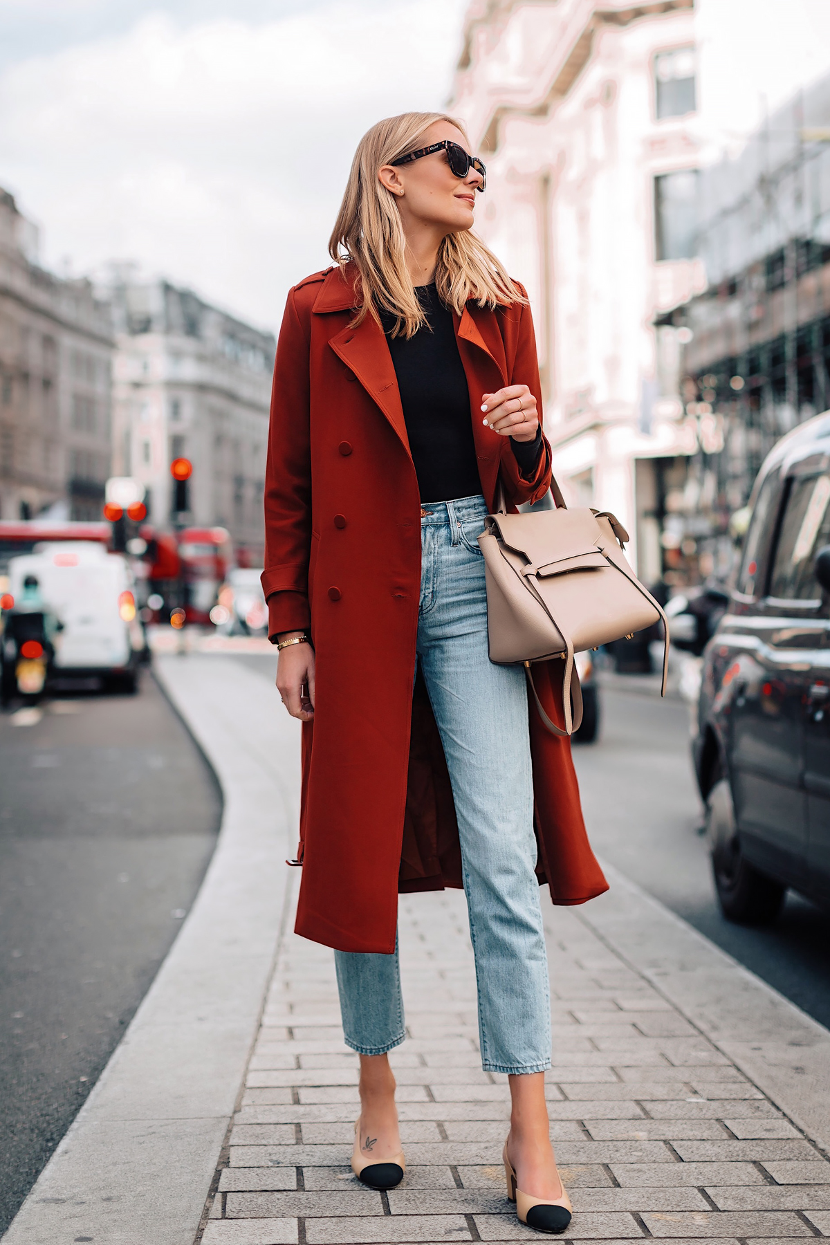 Blonde Woman Wearing Red Trench Coat Black Top Relaxed Jeans Outfit Chanel Slingbacks Celine Mini Belt Bag Fashion Jackson San Diego Fashion Blogger London Street Style