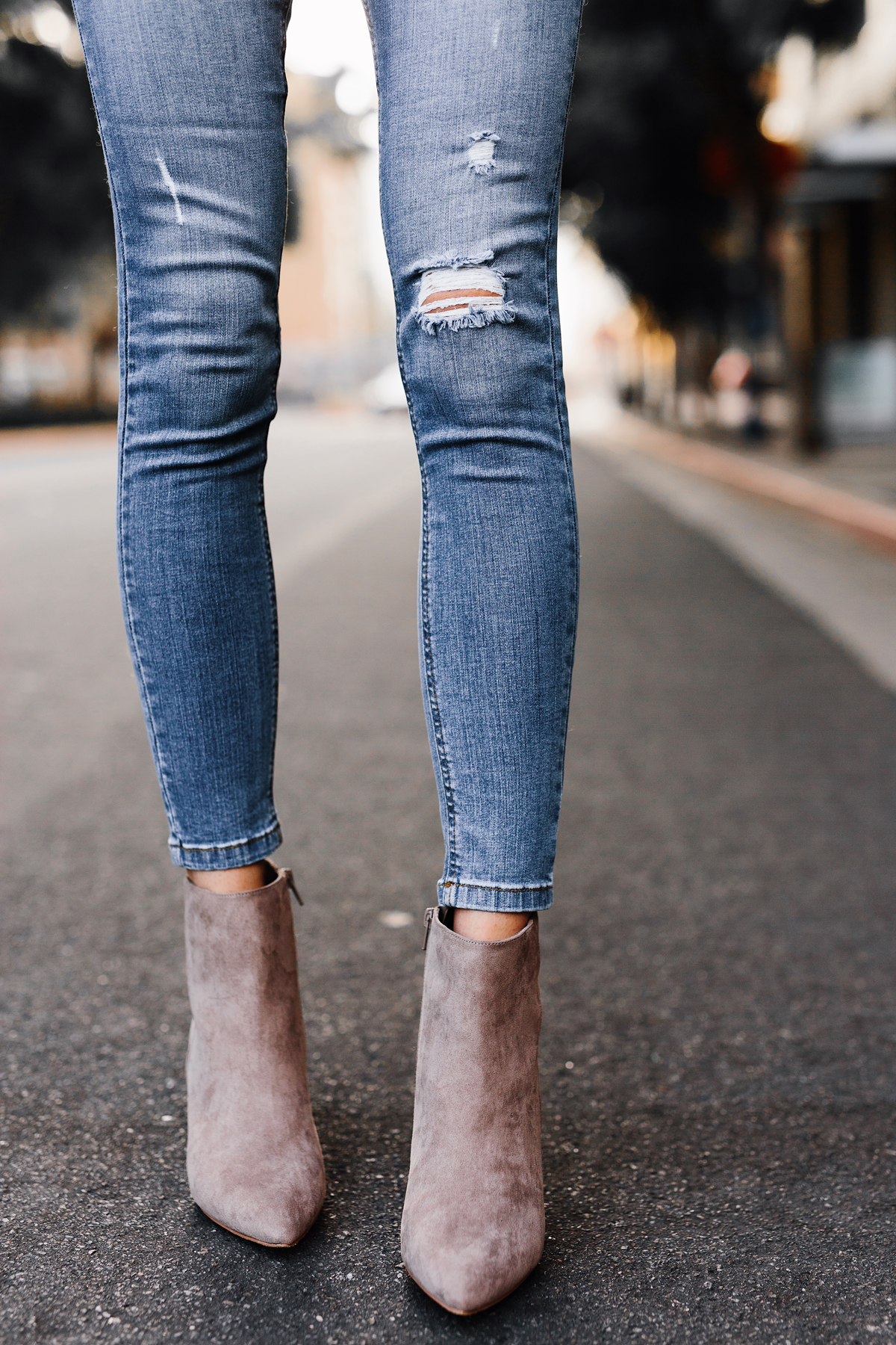 Woman Wearing Steve Madden Taupe Booties Denim Ripped Skinny Jeans Outfit Fashion Jackson San Diego Fashion Blogger Street Style