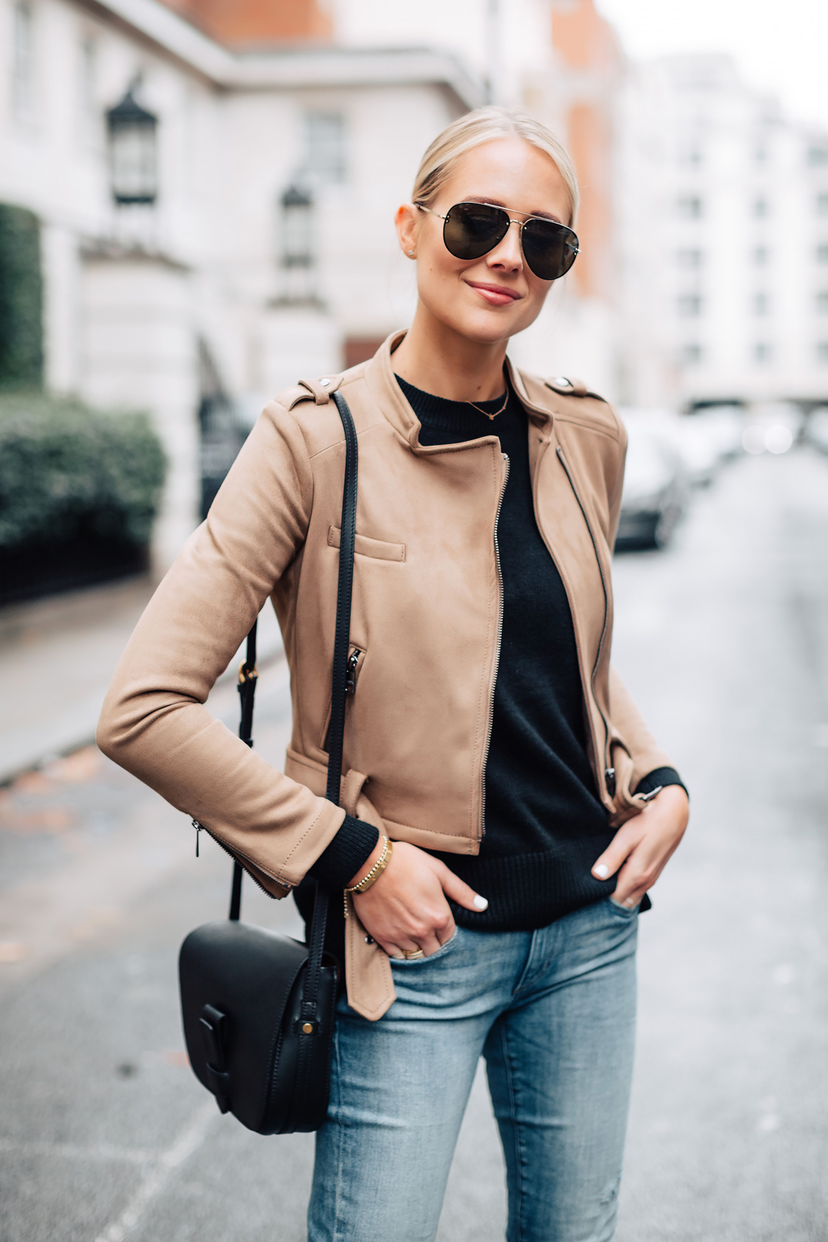 Blonde Woman Wearing Tan Suede Moto Jacket Black Sweater Denim Skinny Jeans Black Handbag Fashion Jackson San Diego Fashion Blogger London Street Style