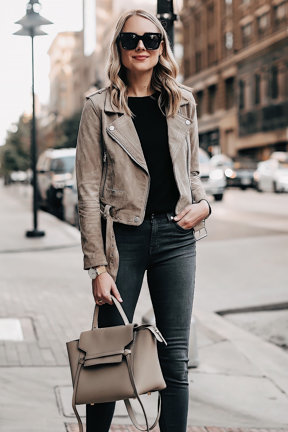 Blonde Woman Wearing Tan Suede Moto Jacket Black Top Grey Skinny Jeans Celine Mini Belt Bag Taupe Fashion Jackson San Diego Fashion Blogger Street Style