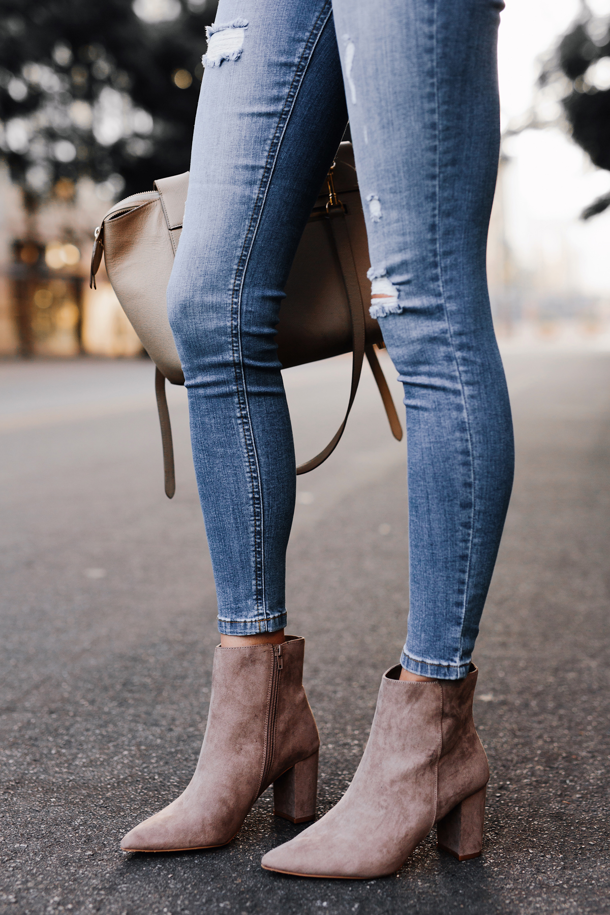 Woman Wearing Walmart Denim Ripped Skinny Jeans Steve Madden Taupe Booties Outfit Fashion Jackson San Diego Fashion Blogger Street Style