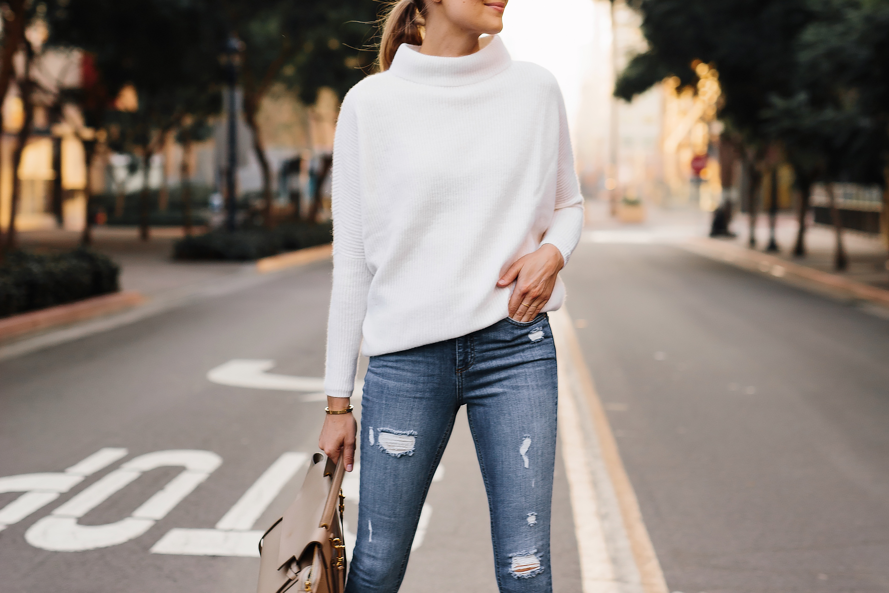 Woman Wearing Walmart White Mock Neck Sweater Denim Ripped Skinny Jeans Outfit Fashion Jackson San Diego Fashion Blogger Street Style