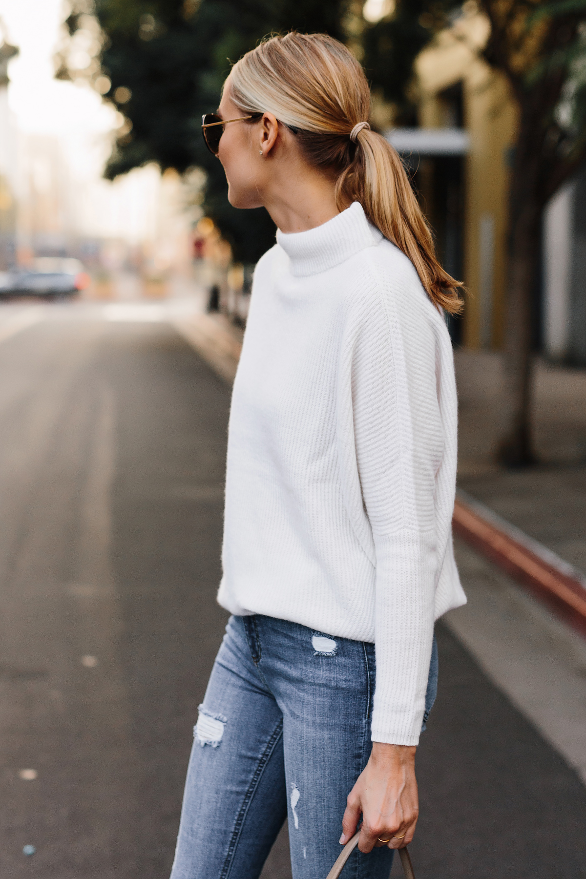 Blonde Woman Wearing White Mock Neck Sweater Denim Ripped Skinny Jeans Outfit Fashion Jackson San Diego Fashion Blogger Street Style