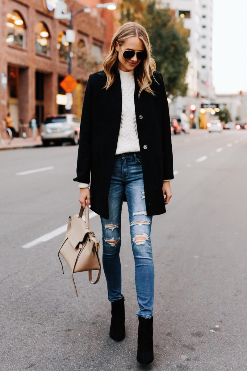 Blonde Woman Wearing Abercrombie Black Wool Coat Cable Knit White Sweater Denim Ripped Skinny Jeans Black Booties Outfit Fashion Jackson San Diego Fashion Blogger Street Style