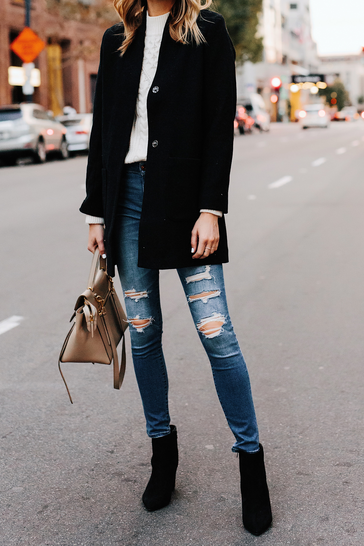 Woman Wearing Abercrombie Black Wool Coat Cable Knit White Sweater Denim Ripped Skinny Jeans Black Booties Outfit Fashion Jackson San Diego Fashion Blogger Street Style