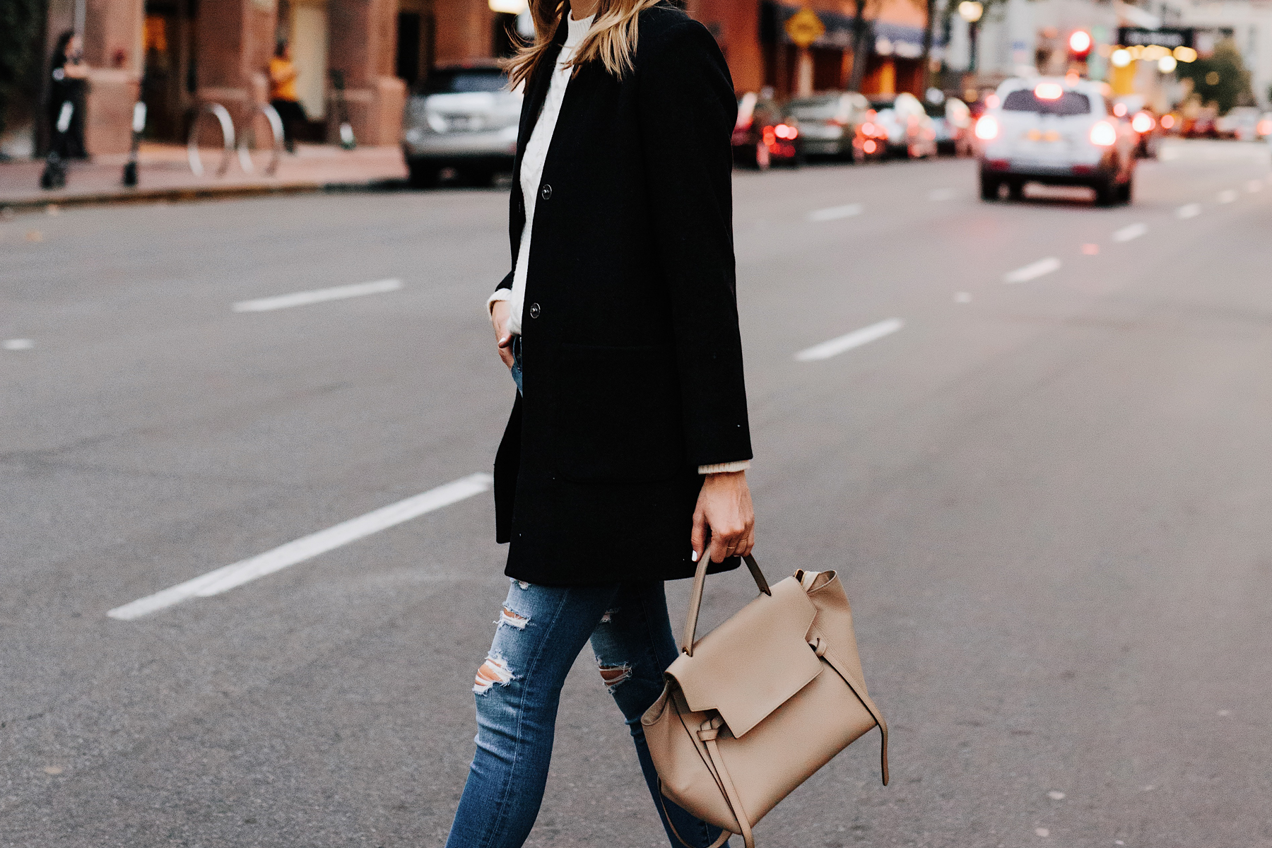 Woman Wearing Abercrombie Black Wool Coat Cable Knit White Sweater Denim Ripped Skinny Jeans Outfit Celine Mini Belt Bag Fashion Jackson San Diego Fashion Blogger Street Style