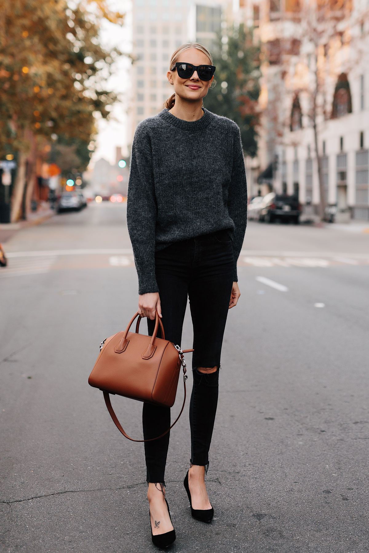 Blonde Woman Wearing Everlane Alpaca Dark Grey Sweater Black Ripped Skinny Jeans Black Heels Tan Satchel Handbag Fashion Jackson San Diego Fashion Blogger Street Style