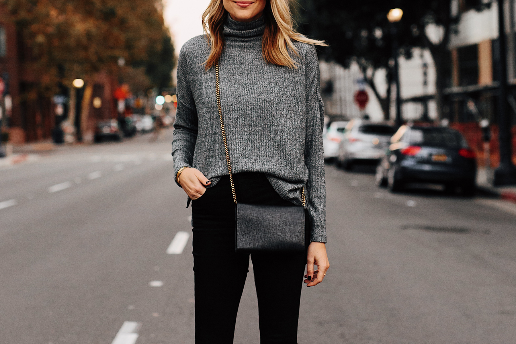 Blonde Woman Wearing Heather Grey Turtleneck Black Skinny Jeans Outfit Black Crossbody Handbag Fashion Jackson San Diego Fashion Blogger Street Style