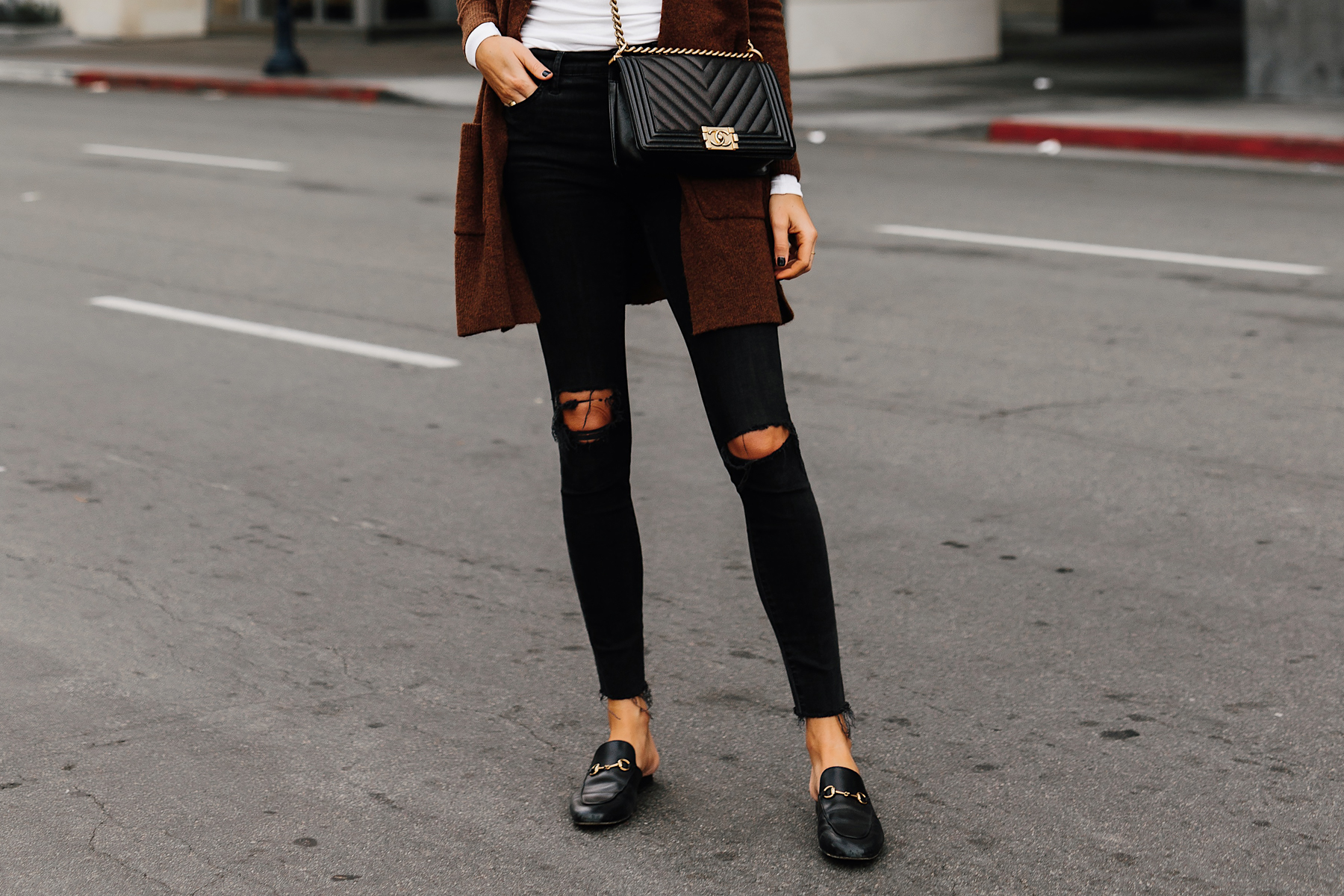 Woman Wearing Madewell Black Ripped Skinny Jeans Gucci Princetown Black Loafer Mules Chanel Black Boy Bag Fashion Jackson San Diego Fashion Blogger Street Style