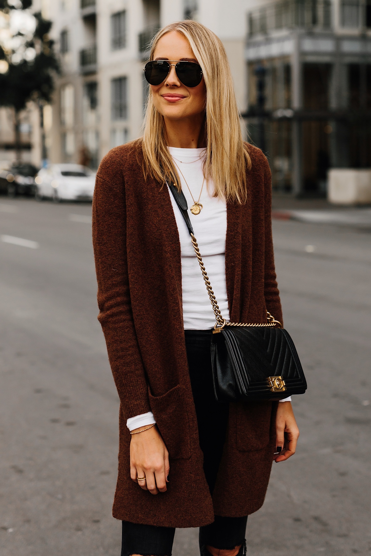 71fb223640d6 Blonde Woman Wearing Madewell Brown Long Cardigan White Top Black Ripped  Skinny Jeans Chanel Black Boy