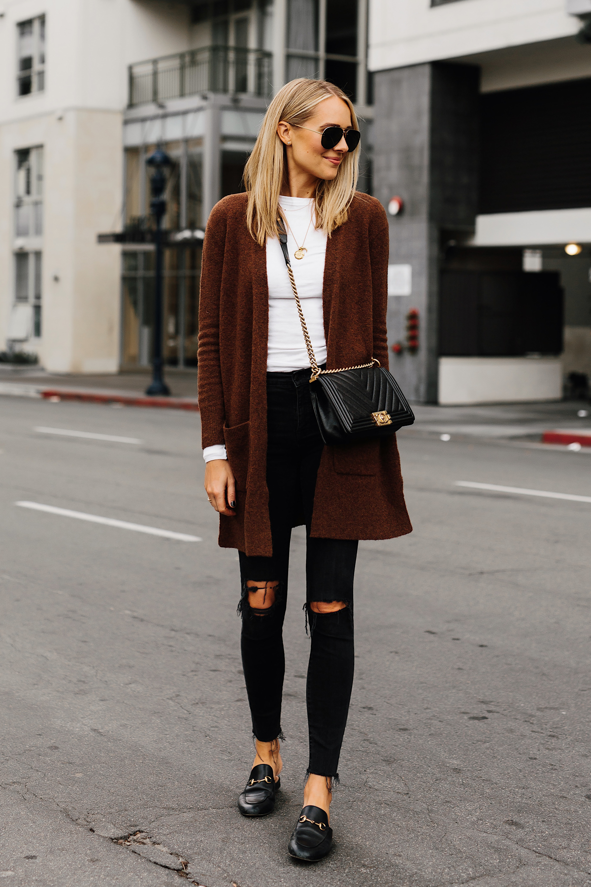 Blonde Woman Wearing Madewell Brown Long Cardigan White Top Madewell Black Ripped Skinny Jeans Gucci Black Princetown Loafer Mules Chanel Black Boy Bag Fashion Jackson San Diego Fashion Blogger Street Style