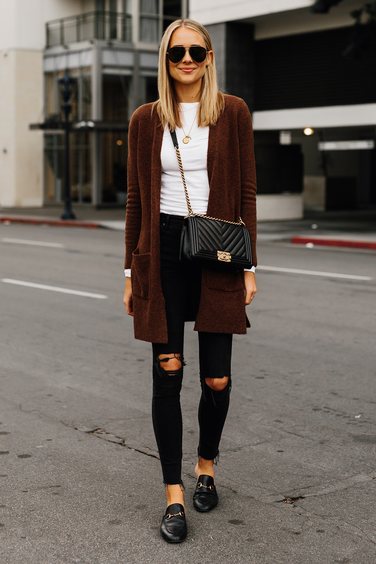 Blonde Woman Wearing Madewell Brown Long Cardigan White Top Madewell Black Ripped Skinny Jeans Gucci Black Princetown Loafer Mules Chanel Black Boy Bag Aviatro Sunglasses Fashion Jackson San Diego Fashion Blogger Street Style