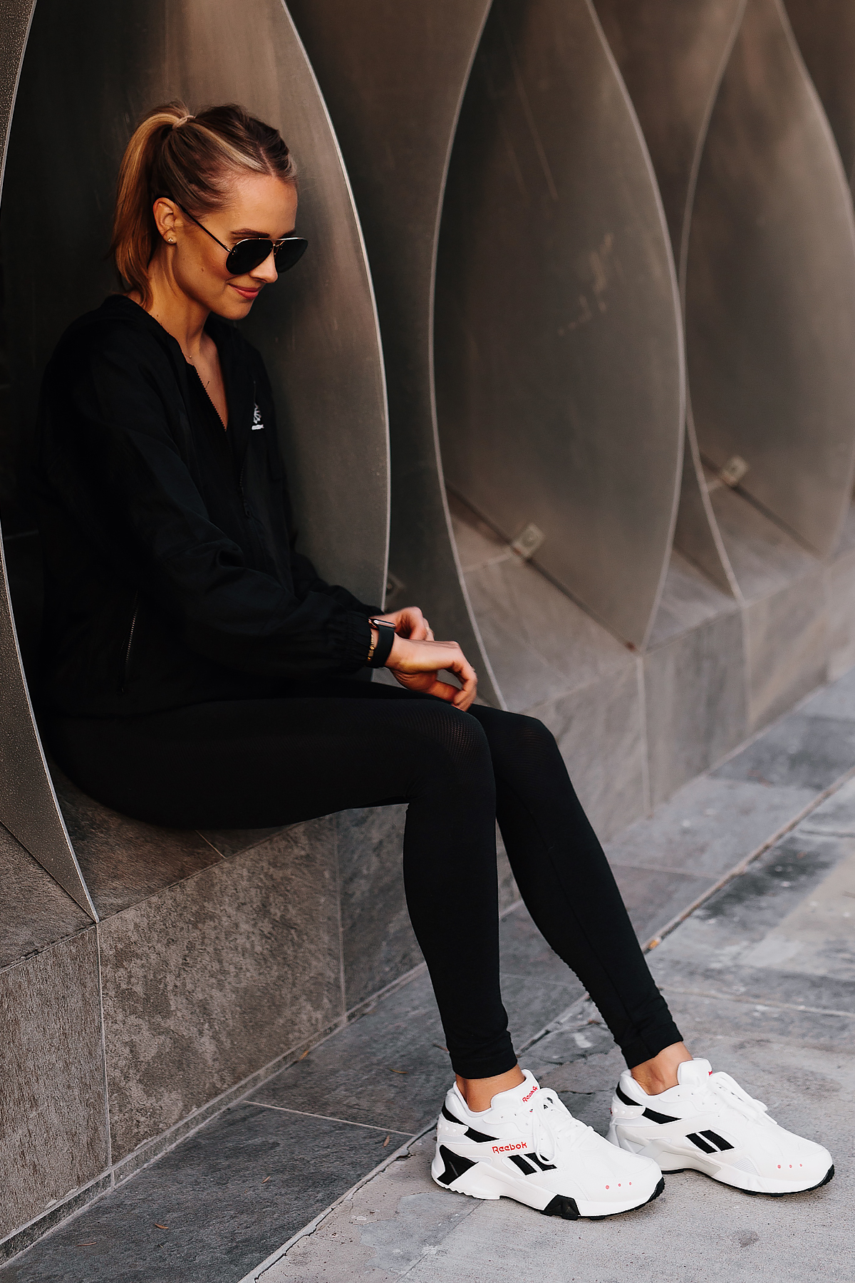 Blonde Woman Wearing Reebok Black Windbreaker Reebok Black Leggings Reebok Aztrek White Sneakers Fashion Jackson San Diego Fashion Blogger Activewear Street Style