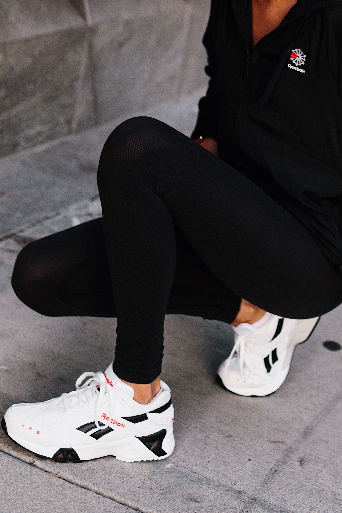 Woman Wearing Reebok Black Windbreaker Reebok Black Leggings Reebok White Aztrek Sneakers Fashion Jackson San Diego Fashion Blogger Activewear Street Style