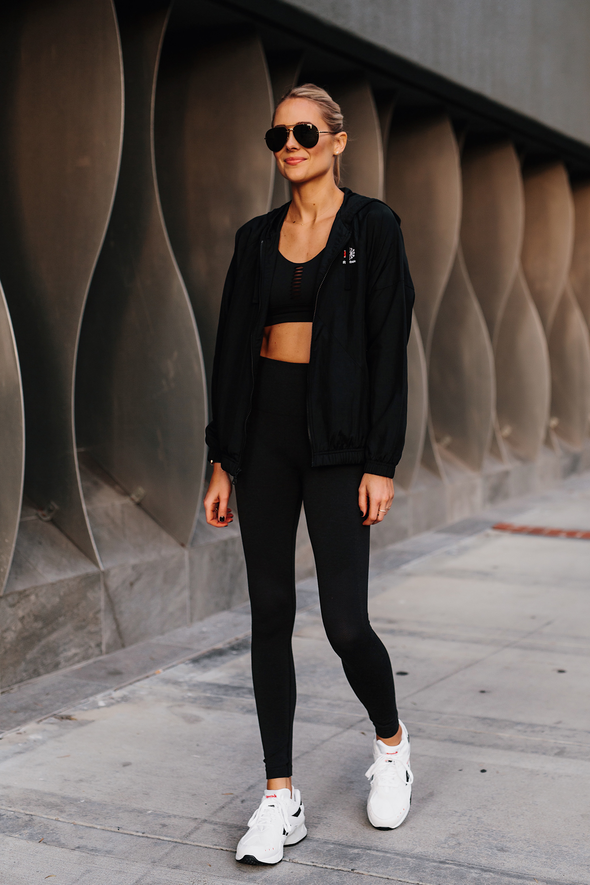 Blonde Woman Wearing Reebok Black Windbreaker Reebok Black Sports Bra Reebok Black Leggings Reebok Aztrek Sneakers White Fashion Jackson San Diego Fashion Blogger Activewear Street Style