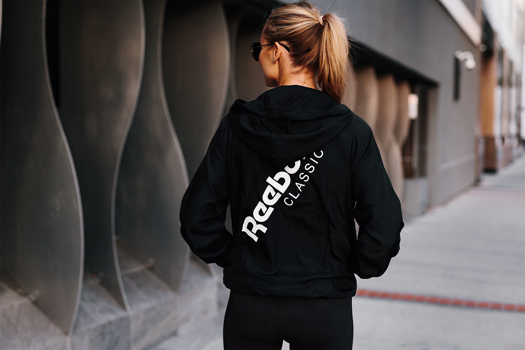 Blonde Woman Wearing Reebok Logo Black Windbreaker Fashion Jackson San Diego Fashion Blogger Activewear Street Style