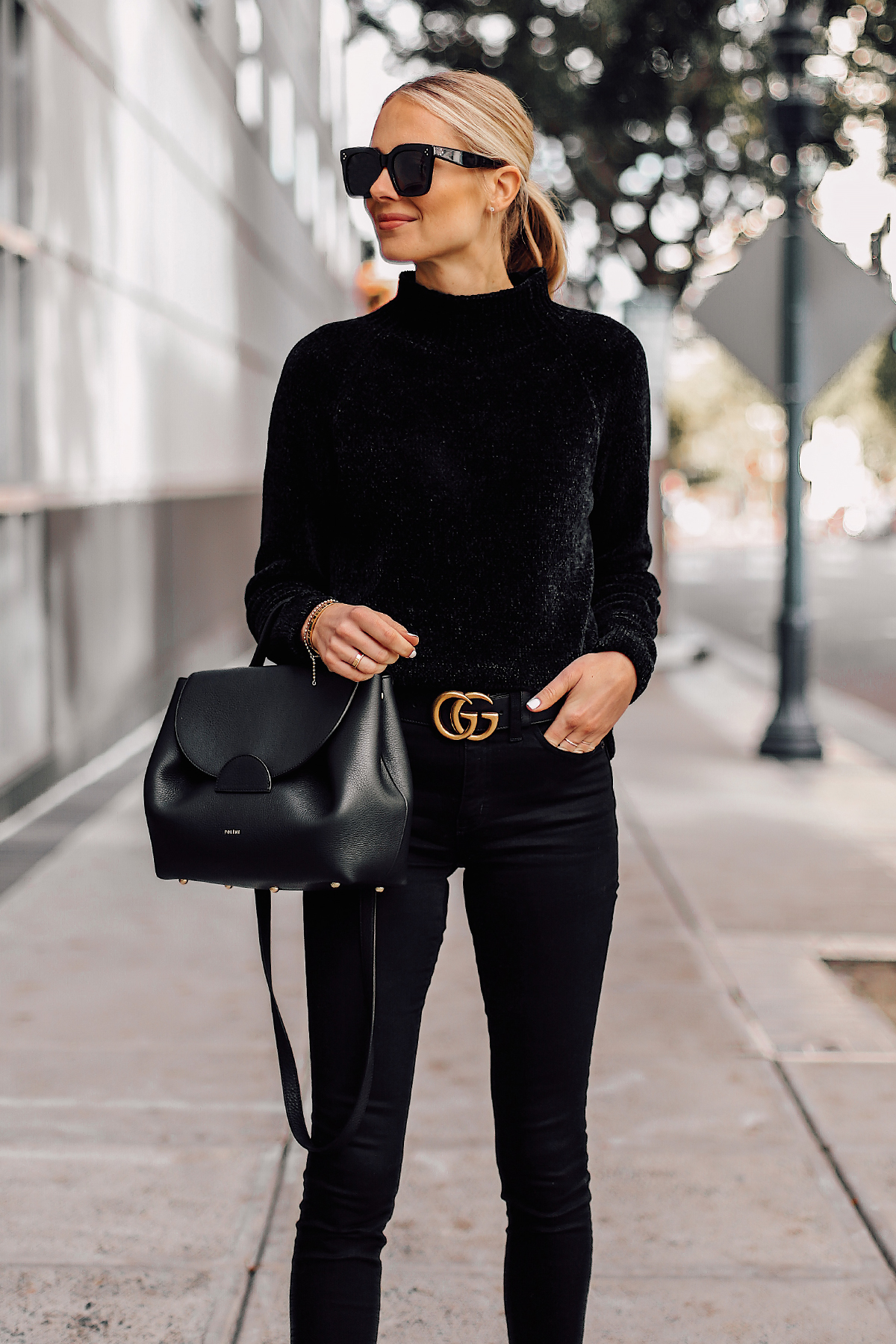 Blonde Woman Wearing Black Chenille Mock Neck Sweater Black Skinny Jeans Black Gucci Belt Black Satchel Handbag Fashion Jackson San Diego Fashion Blogger Street Style