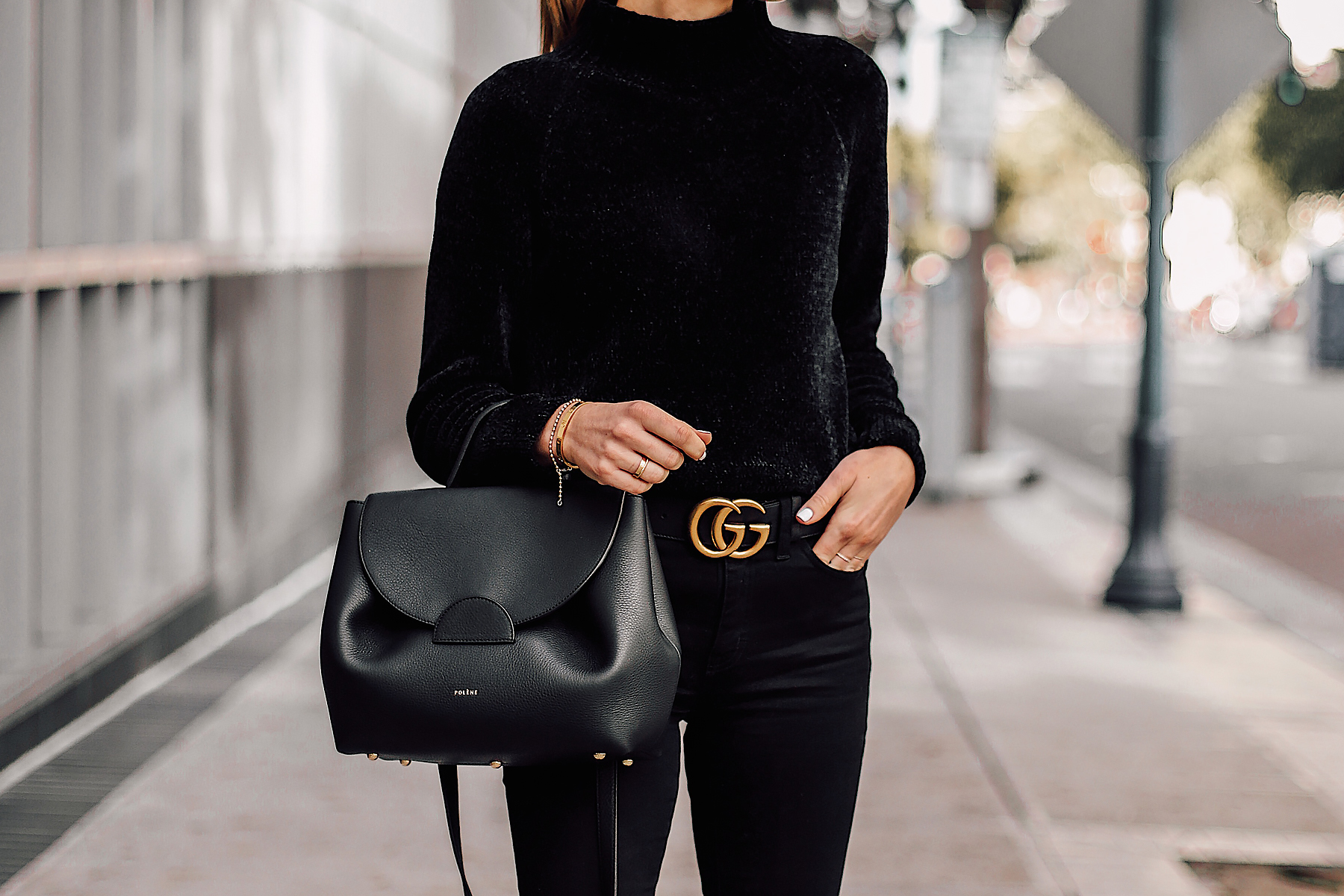 Woman Wearing Black Chenille Mock Neck Sweater Black Skinny Jeans Black Gucci Belt Black Satchel Handbag Fashion Jackson San Diego Fashion Blogger Street Style