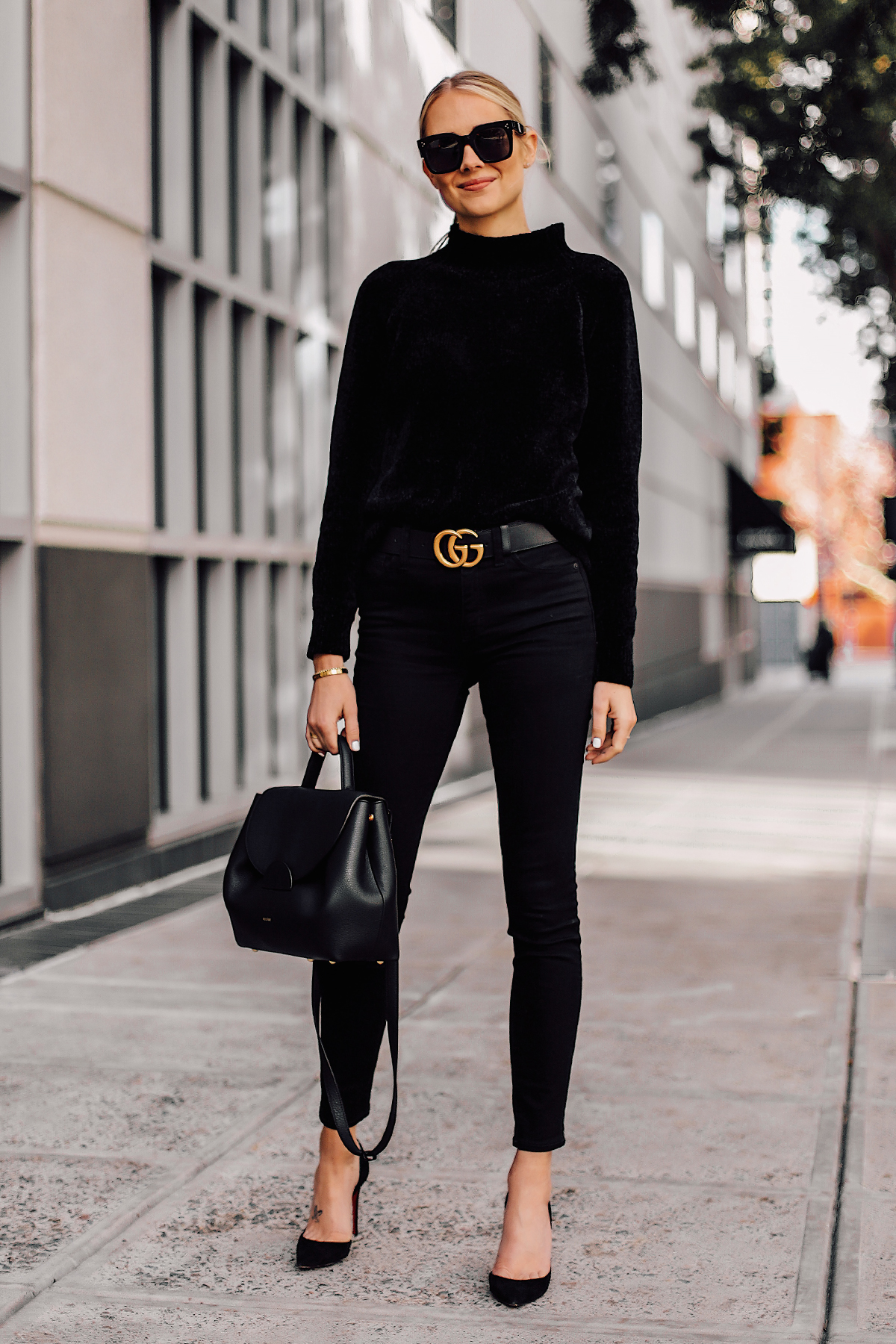 Blonde Woman Wearing Black Chenille Mock Neck Sweater Black Skinny Jeans Black Pumps Black Gucci Belt Black Satchel Handbag Fashion Jackson San Diego Fashion Blogger Street Style