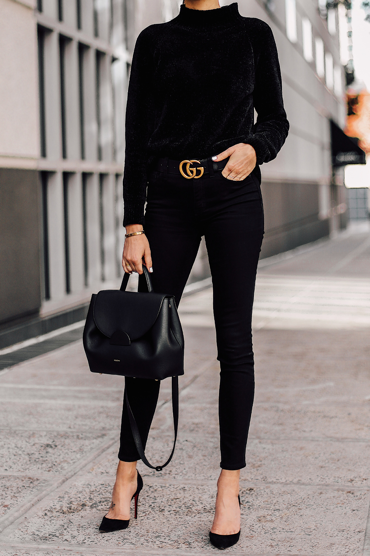 Woman Wearing Black Chenille Sweater Black Skinny Jeans Black Pumps Black Gucci Belt Black Satchel Handbag Fashion Jackson San Diego Fashion Blogger Street Style