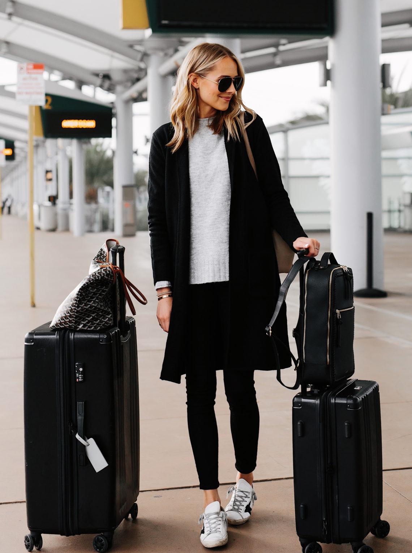 Fashion Jackson Wearing Black Coatigan Grey Sweater Black Skinny Jeans Golden Goose Sneakers Airport Outfit Calpak Black Luggage Set Goyard Tote