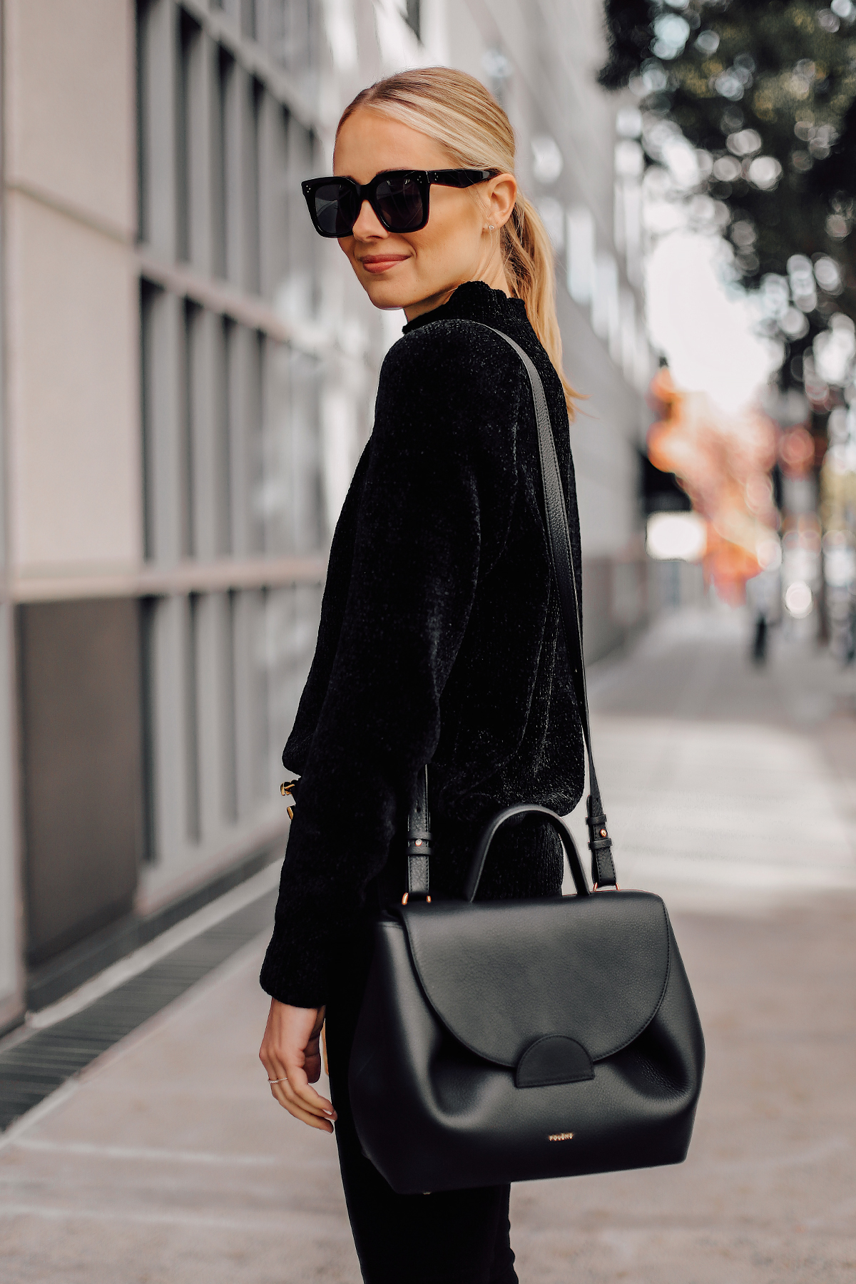 Blonde Woman Wearing Black Sweater Black Satchel Handbag Fashion Jackson San Diego Fashion Blogger Street Style