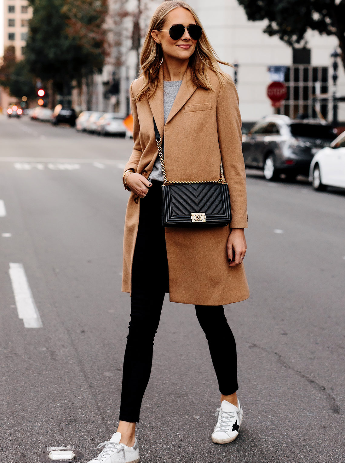 Blonde Woman Wearing Wearing Camel Coat Black Skinny Jeans Golden Goose Sneakers Outfit Chanel Black Boy Bag Fashion Jackson San Diego Fashion Blogger Street Style