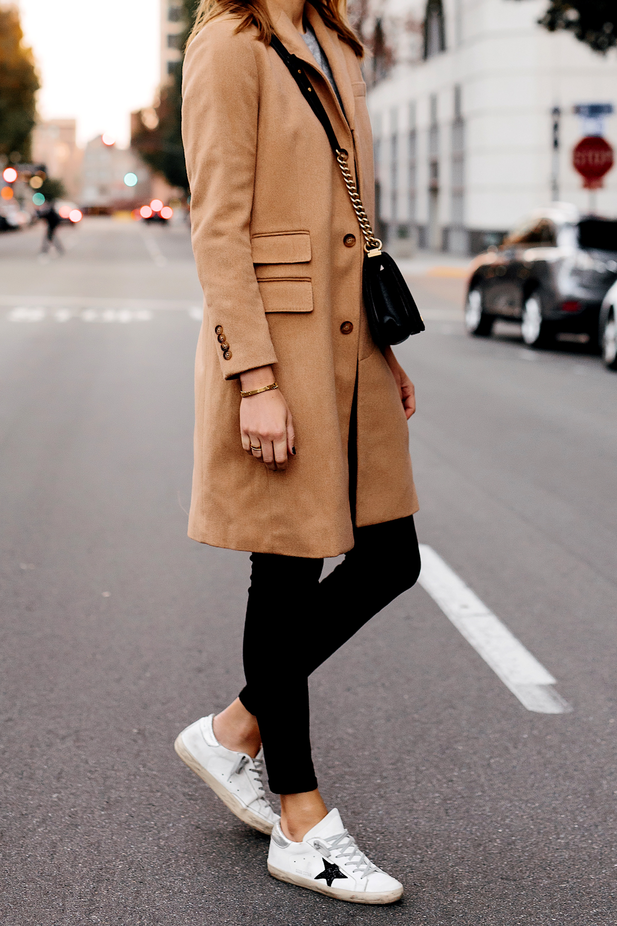 Woman Wearing Camel Coat Black Skinny Jeans Golden Goose Sneakers Outfit Fashion Jackson San Diego Fashion Blogger Street Style