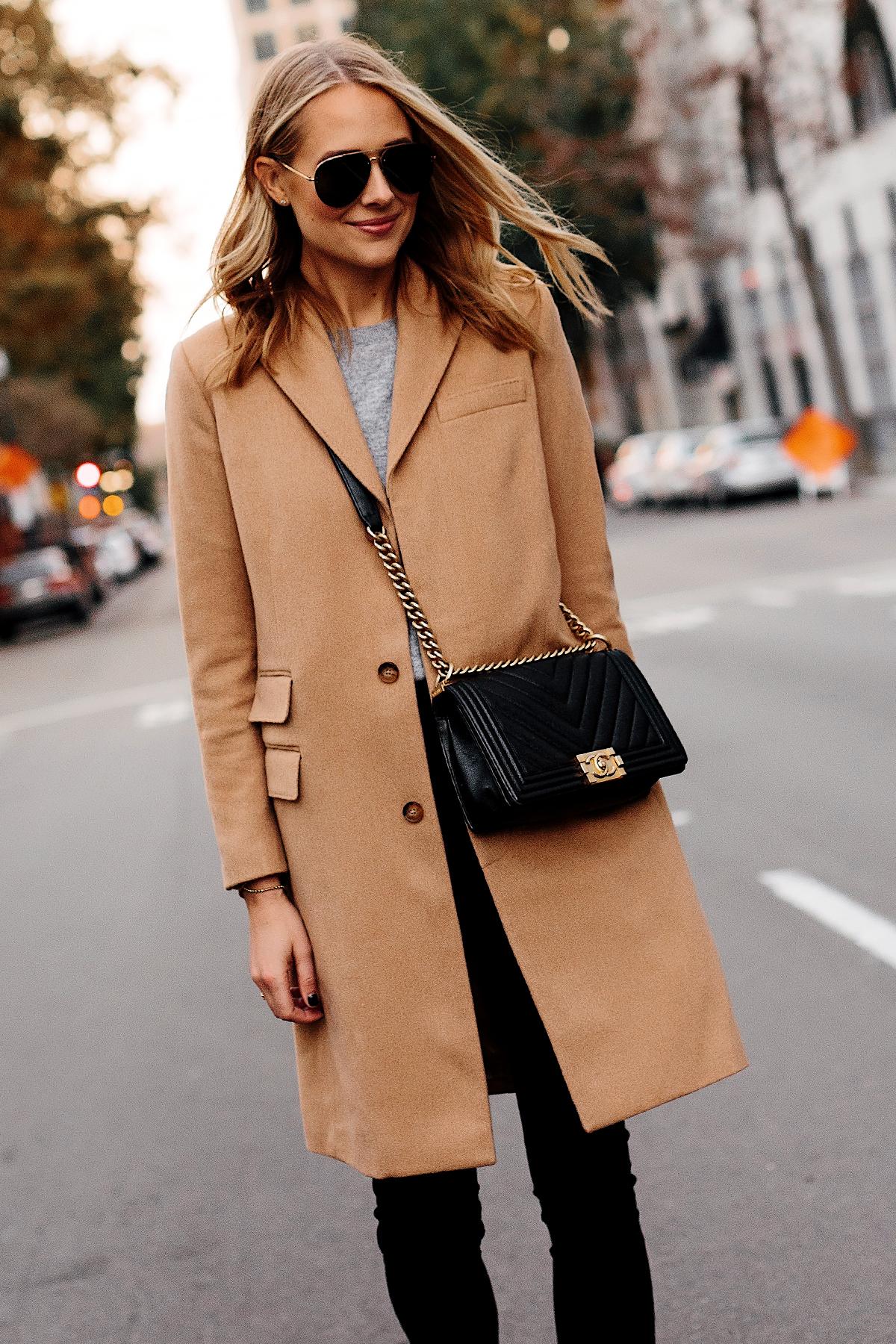 Blonde Woman Wearing Camel Coat Grey Sweater Black Skinny Jeans Outfit Chanel Black Boy Bag Fashion Jackson San Diego Fashion Blogger Street Style
