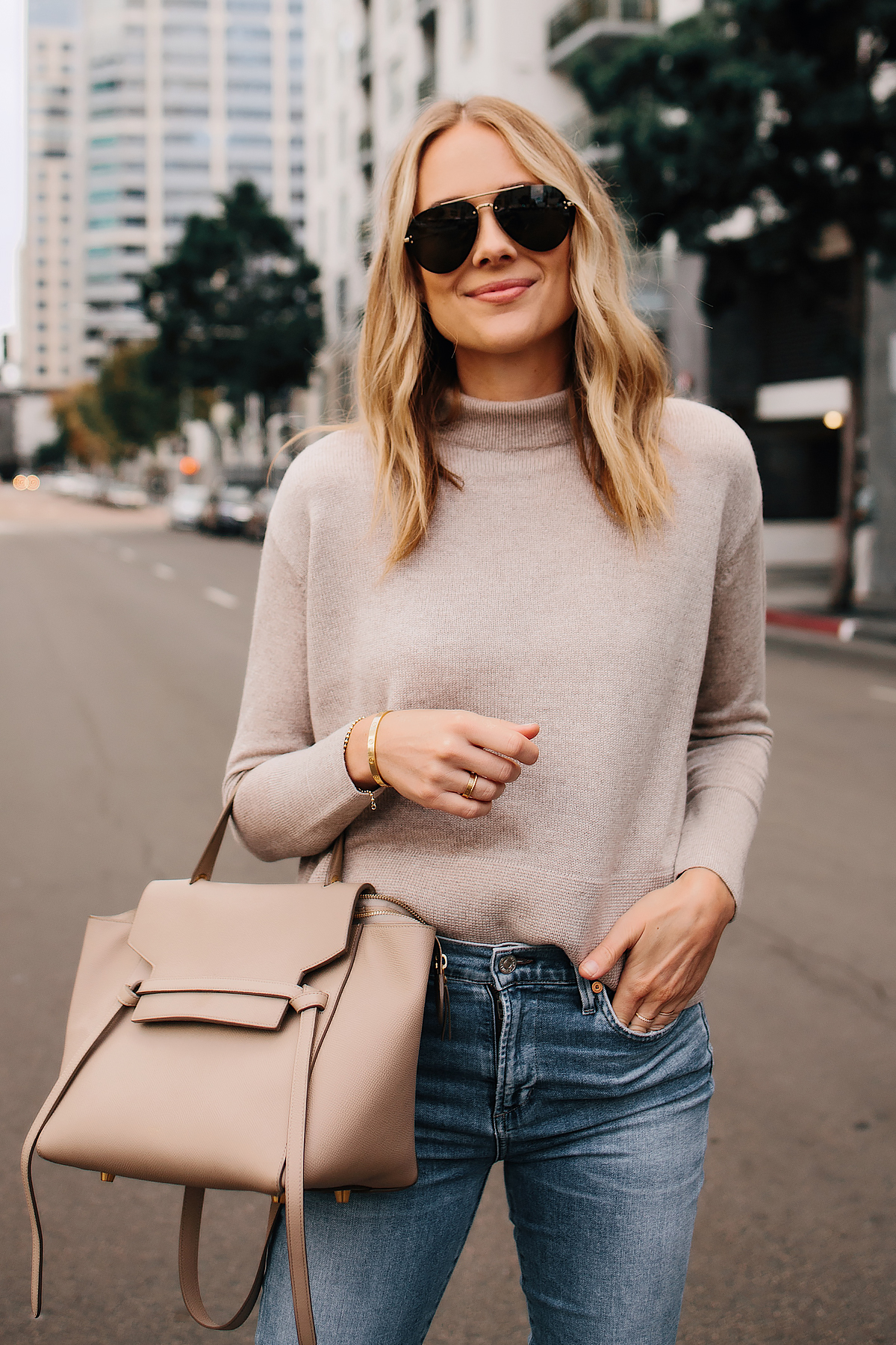 d94f793b623 Blonde Woman Wearing Everlane Cashmere Sweater Denim Skinny Jeans Celine  Mini Belt Bag Outfit Fashion Jackson