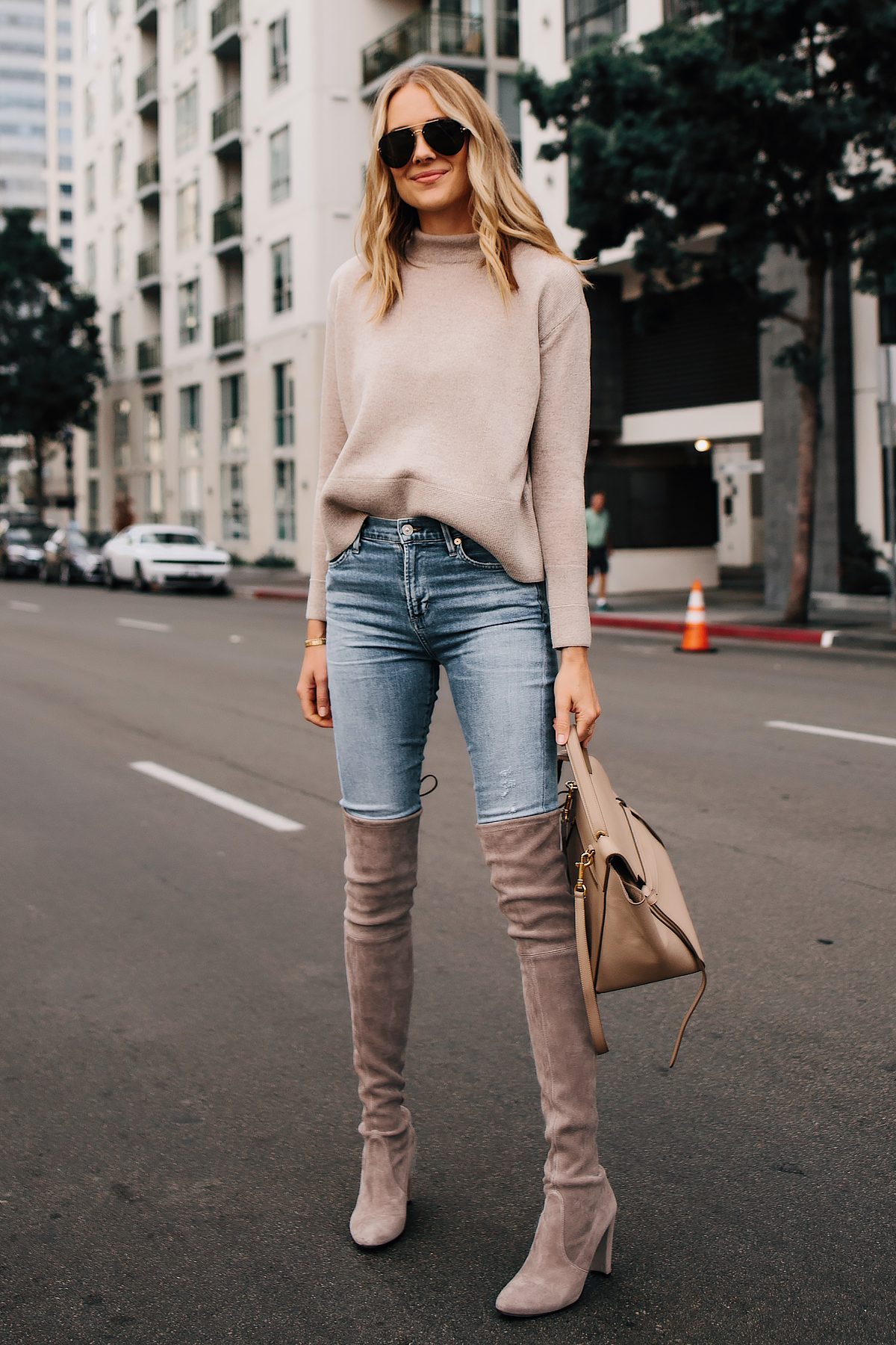 Blonde Woman Wearing Wearing Everlane Cashmere Sweater Denim Skinny Jeans Stuart Weitzman Taupe Over the Knee Boots Outfit Fashion Jackson San Diego Fashion Blogger Street Style