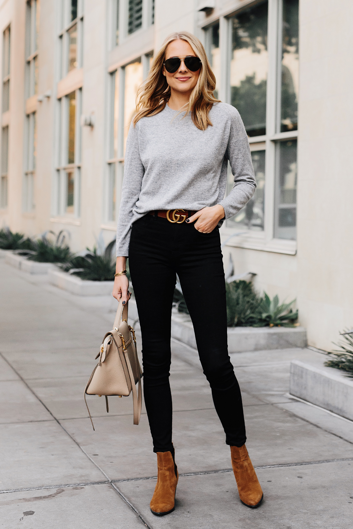 Blonde Woman Wearing Vince Grey Sweater Black Skinny Jeans Gucci Logo Belt Tan Booties Celine Mini Belt Bag Fashion Jackson San Diego Fashion Blogger Street Style