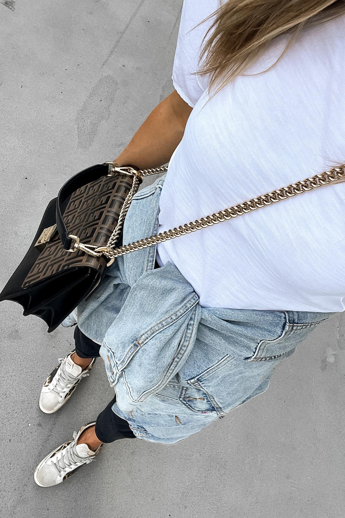 Fashion Jackson Wearing White Top Black Jeans Denim Jacket Leopard Golden Goose Sneakers Fendi Handbag
