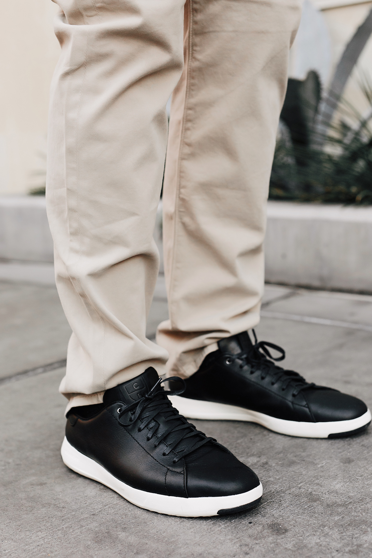 Mens Fashion Blogger Wearing AG Tan Twill Pants Cole Haan Black Sneakers