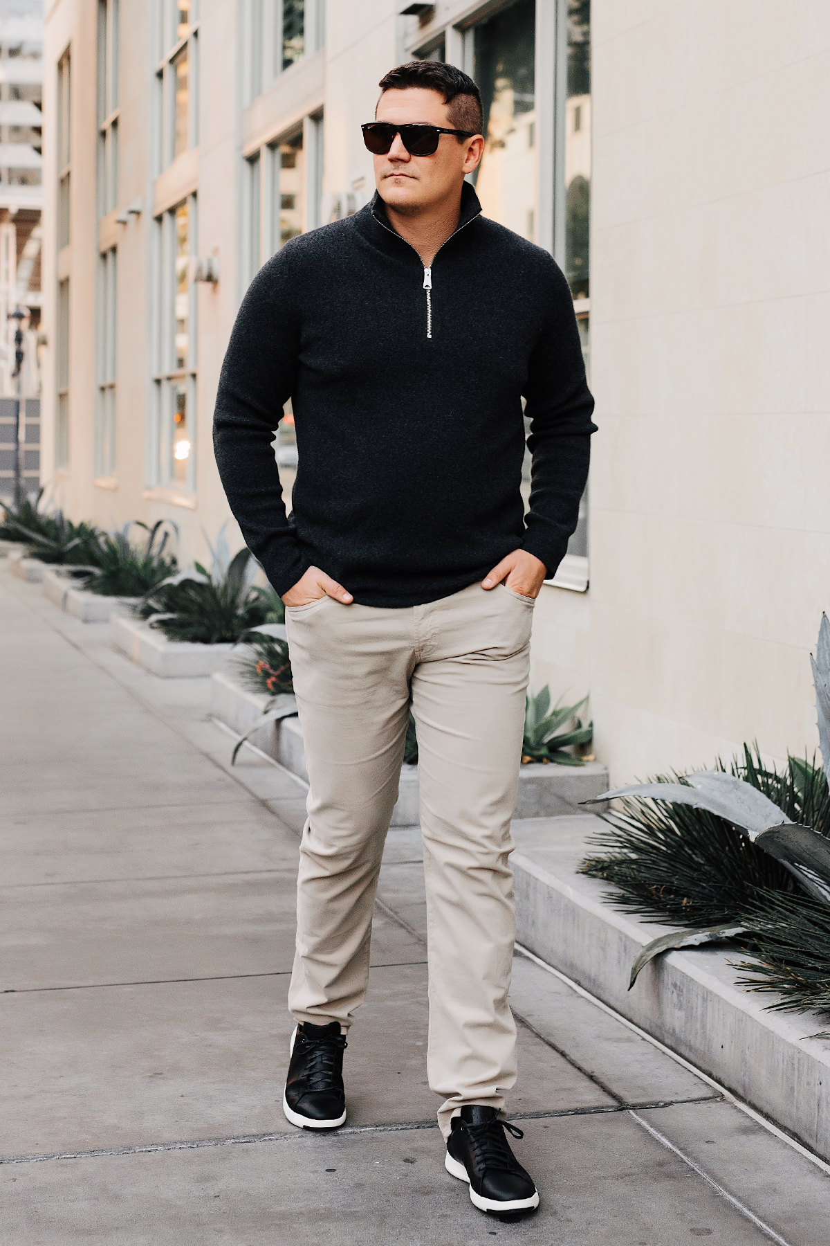 Mens Fashion Blogger Wearing Burberry Quarter Zip Cashmere Sweater AG Tan Twill Pants Cole Haan Black Sneakers