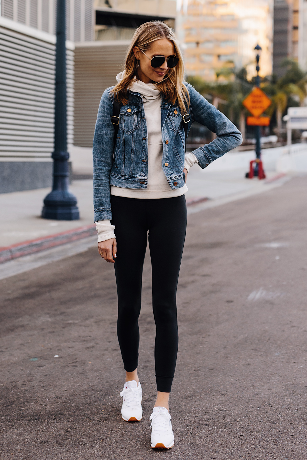 Fashion Jackson Athleisure Outfit Denim Jacket Grey Sweatshirt Black Leggings Reebok Classic White Sneakers Fashion Jackson San Diego Fashion Blogger Street Style