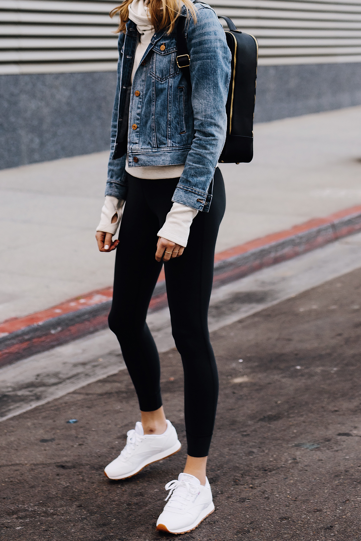 Blonde Woman Wearing Athleisure Outfit Denim Jacket Grey Sweatshirt Black Leggings Reebok Classic White Sneakers Black Fashion Jackson San Diego Fashion Blogger Street Style