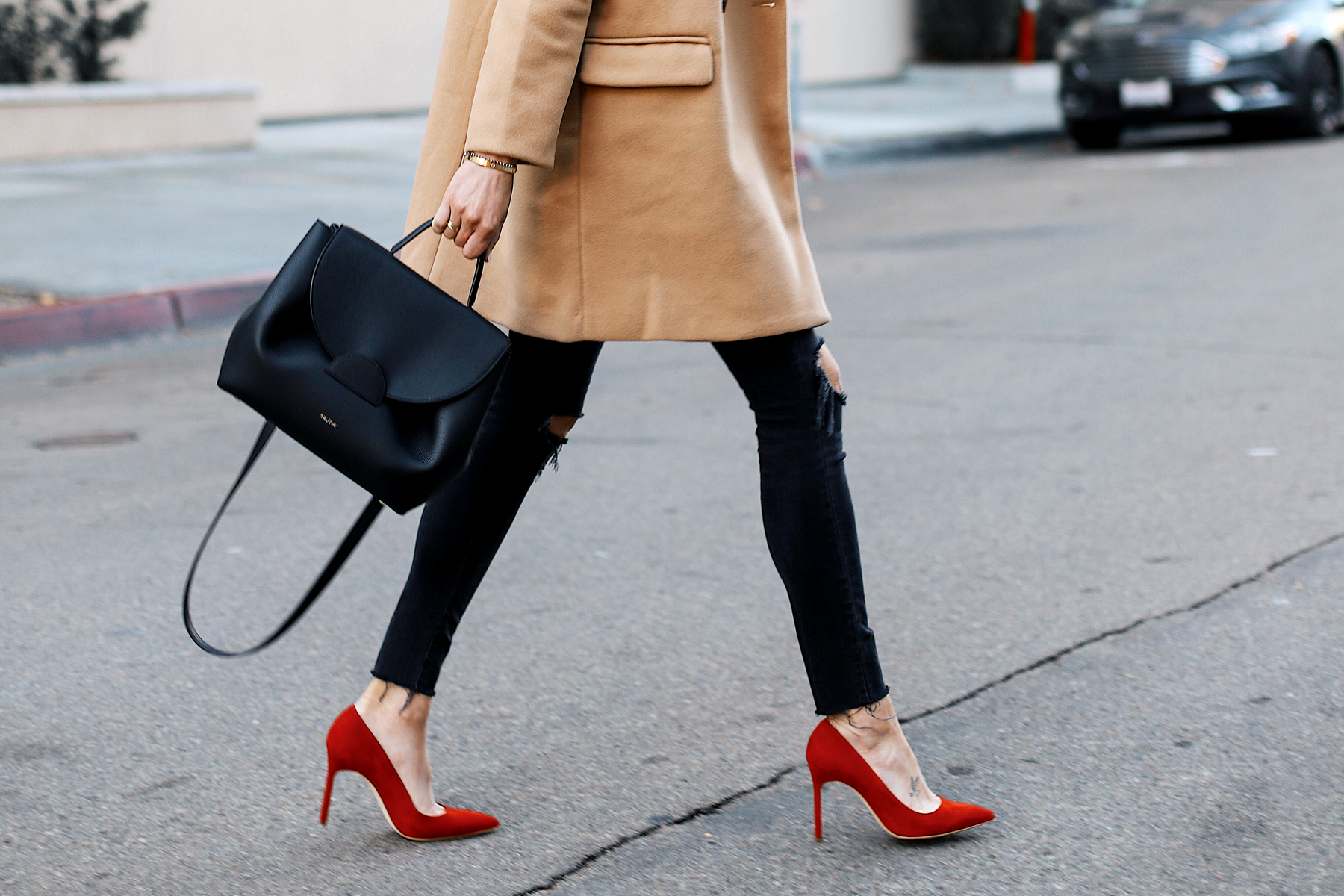 Woman Wearing Camel Coat Black Skinny Jeans Manolo Blahnik BB Red Pumps Polene Black Satchel Handbag Fashion Jackson San Diego Fashion Blogger Street Style