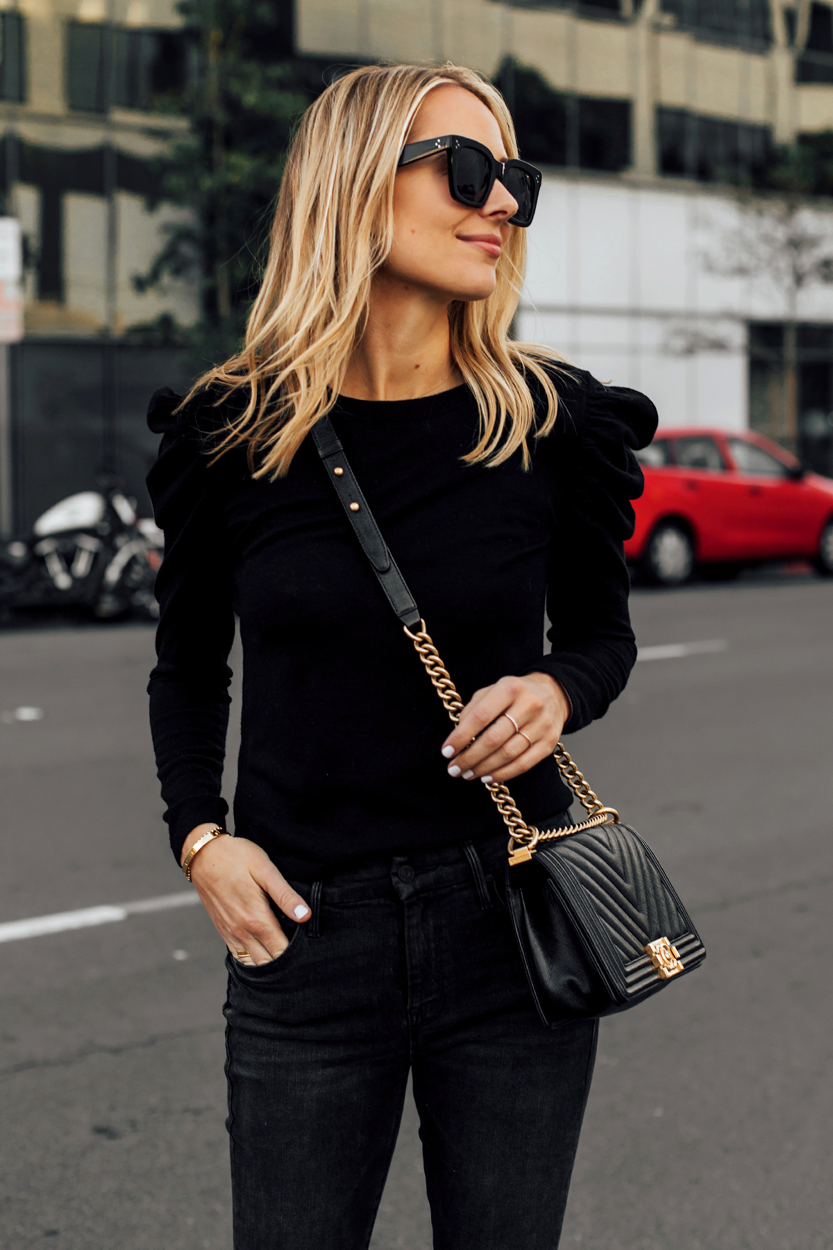 07a5e616fd394 ... Fashion Jackson San Diego. Blonde Woman Wearing Alice and Olivia Black  Lidia Sweater Black Skinny Jeans Chanel Black Boy Bag