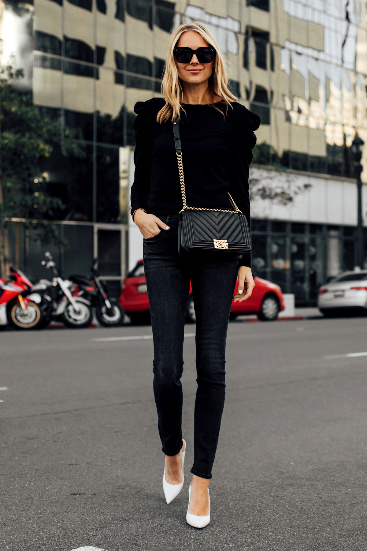 5a9e07f77ea3a Blonde Woman Wearing Alice and Olivia Black Lidia Sweater Mother Denim Black  Skinny Jeans White Pumps