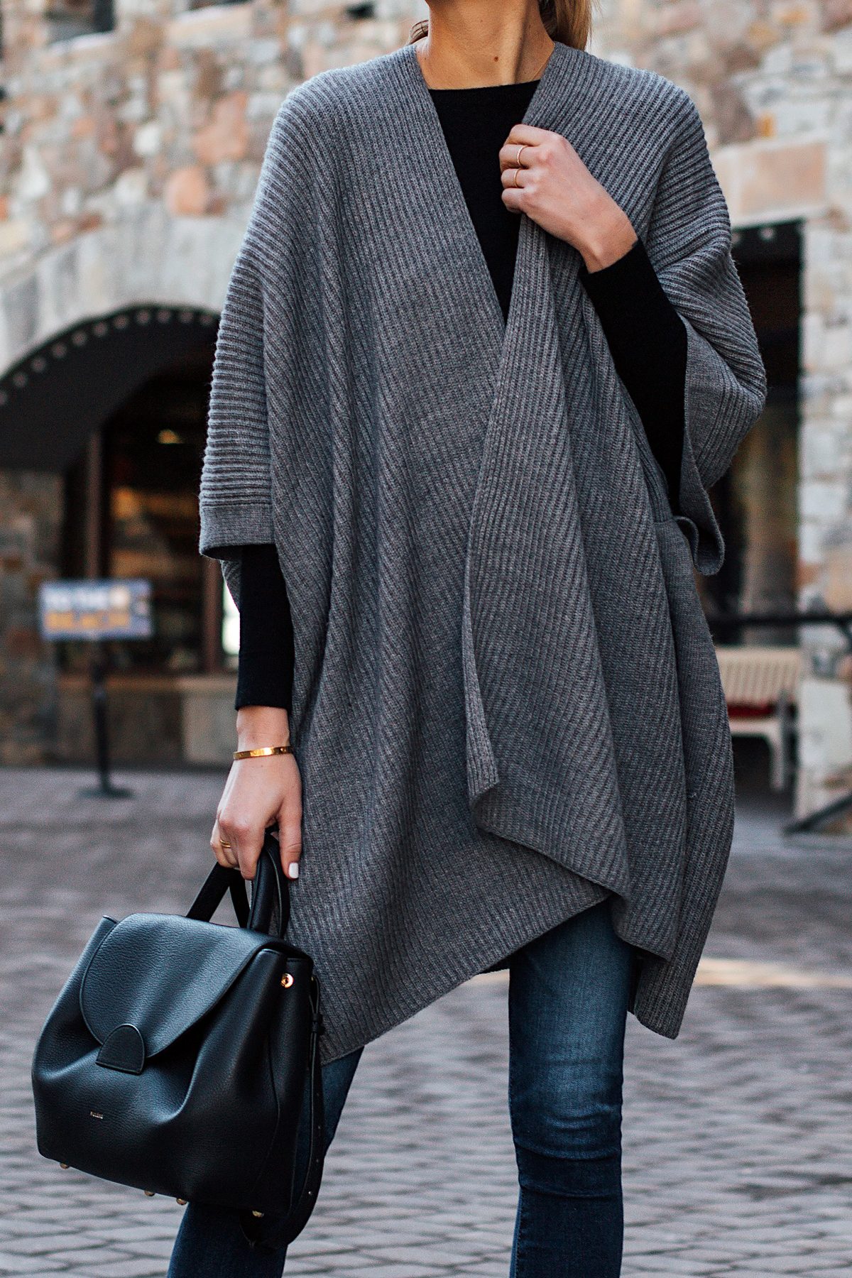 Woman Wearing All Saints Grey Sweater Poncho Denim Skinny Jeans Polene Black Handbag Fashion Jackson San Diego Fashion Blogger Street Style