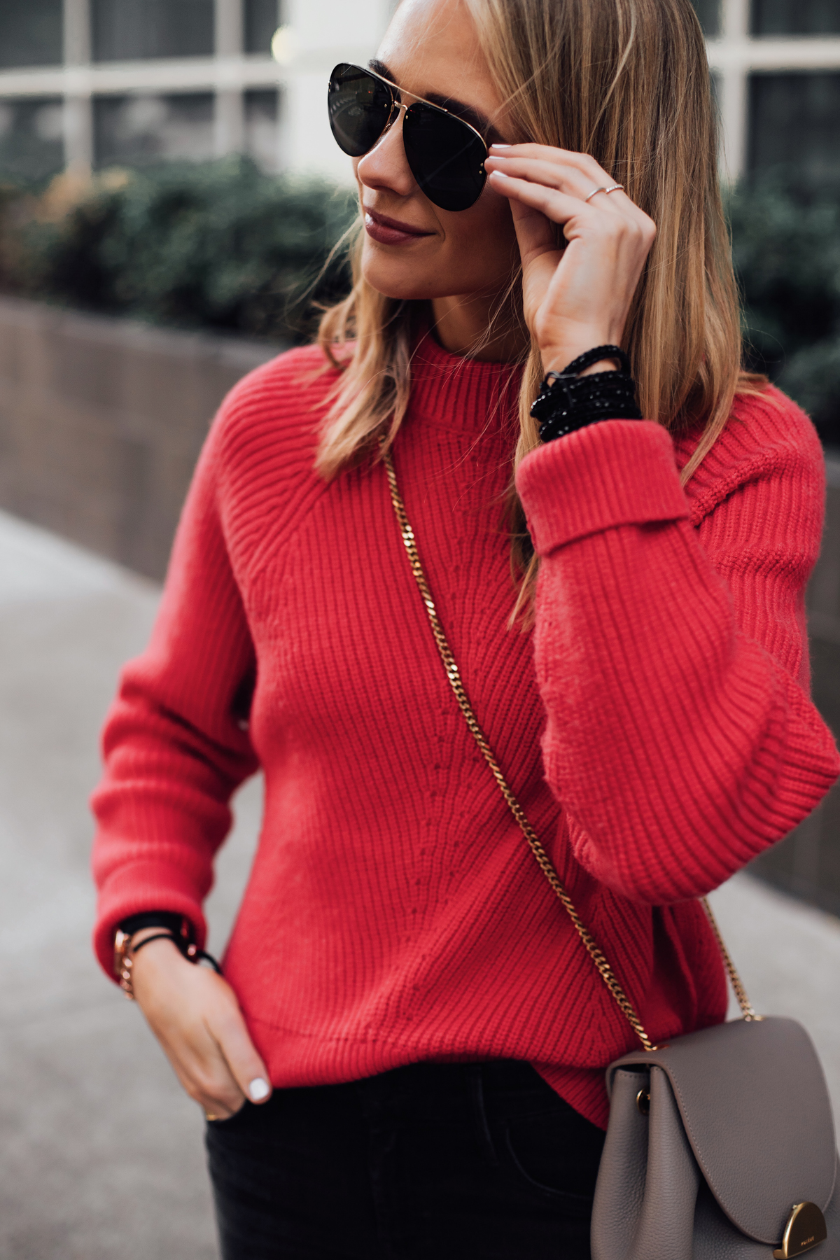 Blonde Woman Wearing AllSaints Red Sweater Victoria Emerson Beaded Black Wrap Bracelet Celine Aviator Sunglasses Fashion Jackson San Diego Fashion Blogger Street Style