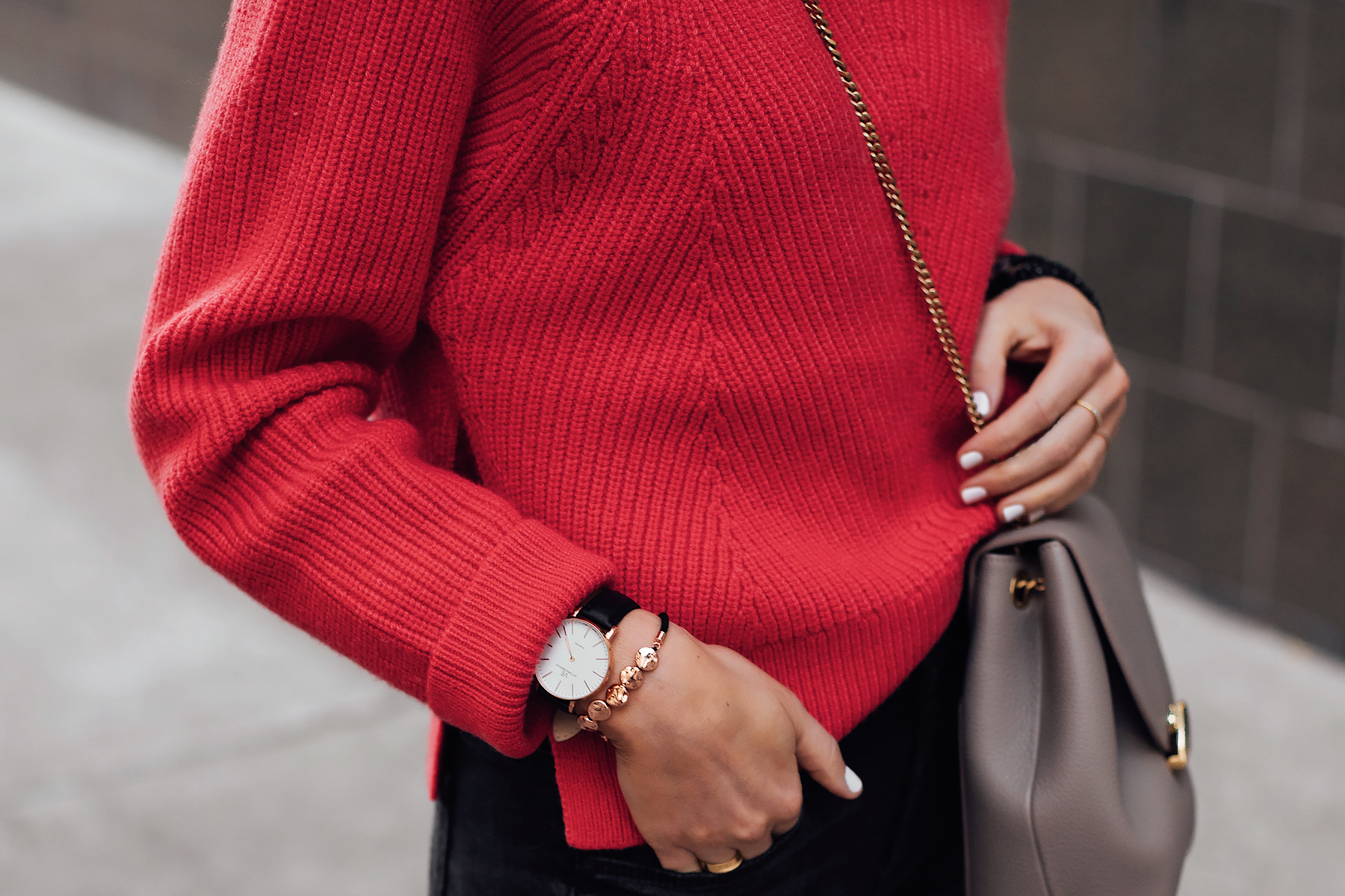 Woman Wearing AllSaints Red Sweater Victoria Emerson Black Rose Gold Watch Rose Gold Beaded Bracelet Fashion Jackson San Diego Fashion Blogger Street Style