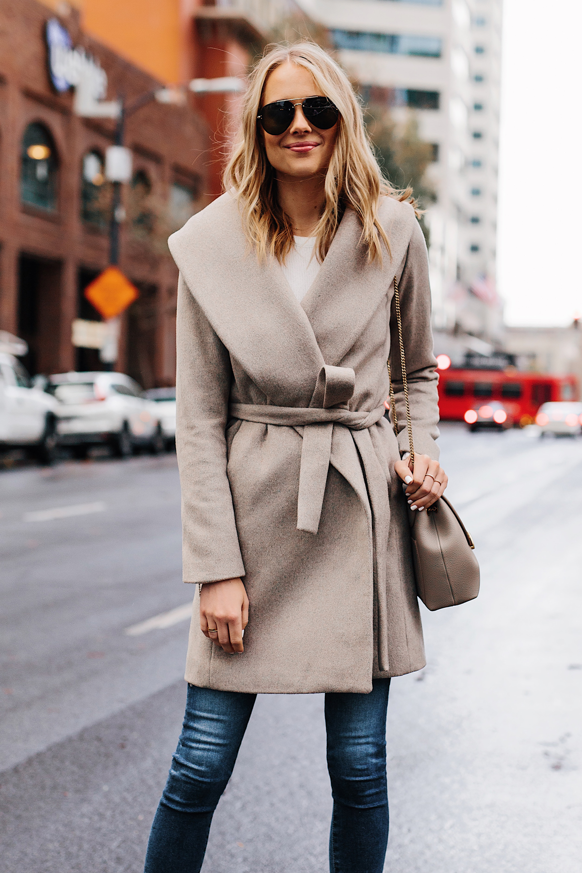 Blonde Woman Wearing Ann Taylor Beige Wrap Coat Denim Skinny Jeans Outfit Fashion Jackson San Diego Fashion Blogger Street Style