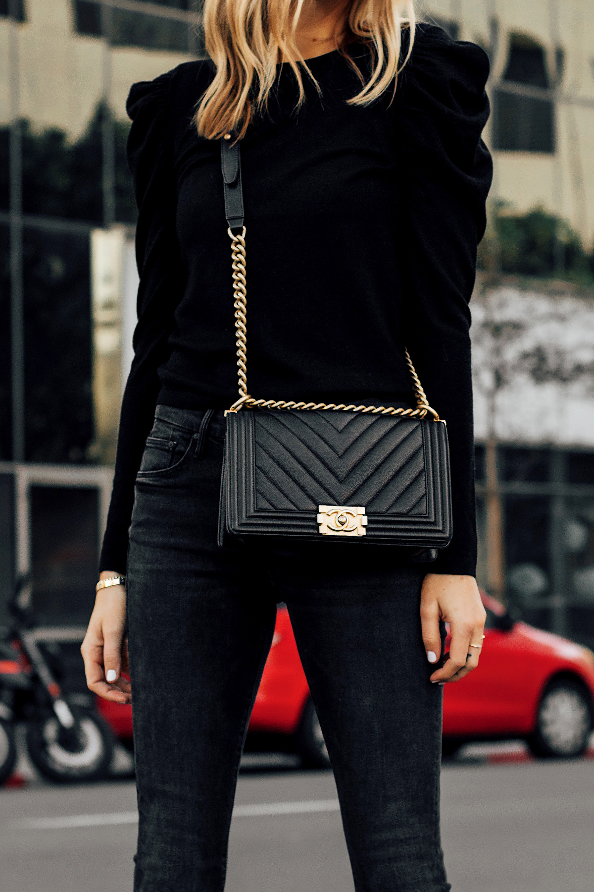 Blonde Woman Wearing Black Alice and Olivia Sweater Black Skinny Jeans Chanel Black Boy Bag Fashion Jackson San Diego Fashion Blogger Street Style