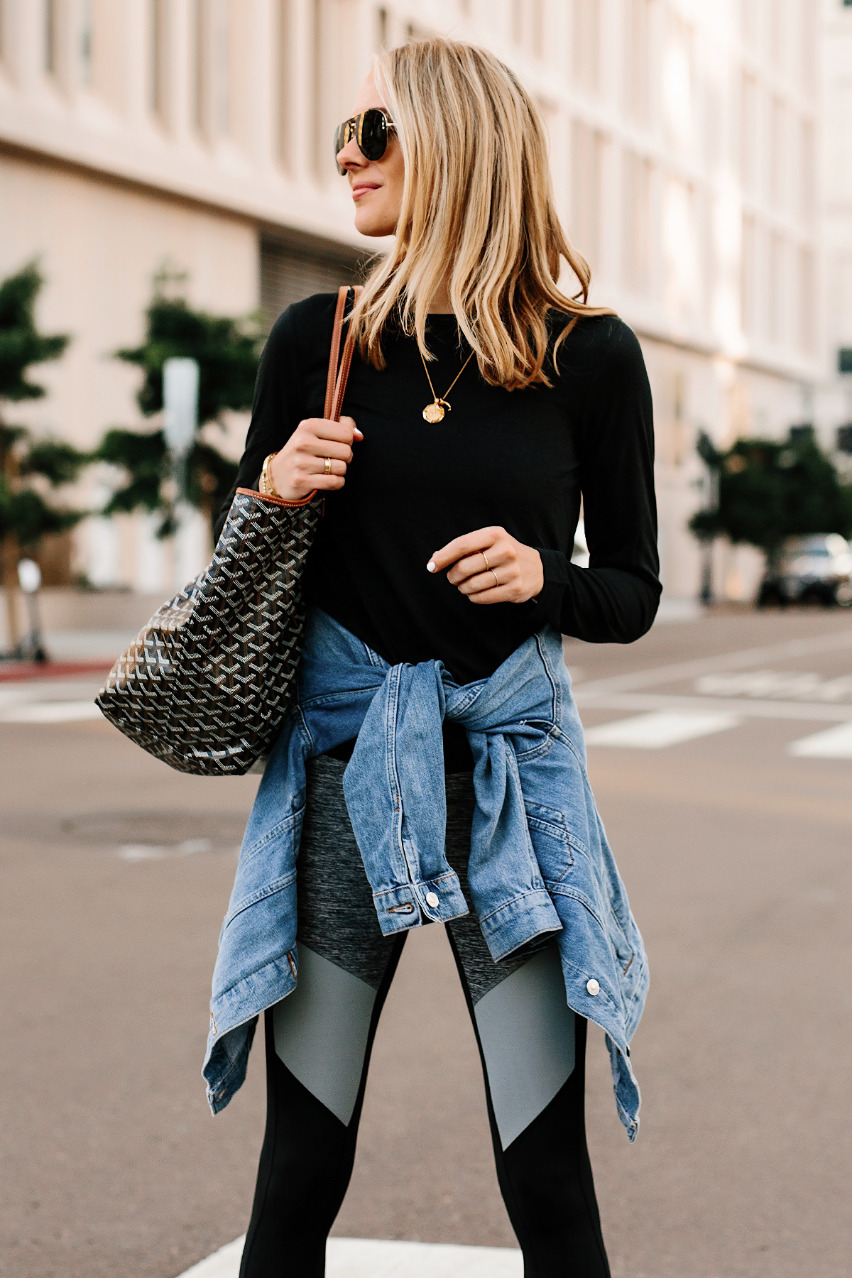 Blonde Woman Wearing Black Long Sleeve Top Denim Jacket Reebok Colorblock Leggings Goyard Tote Fashion Jackson San Diego Fashion Blogger Athleisure Outfit